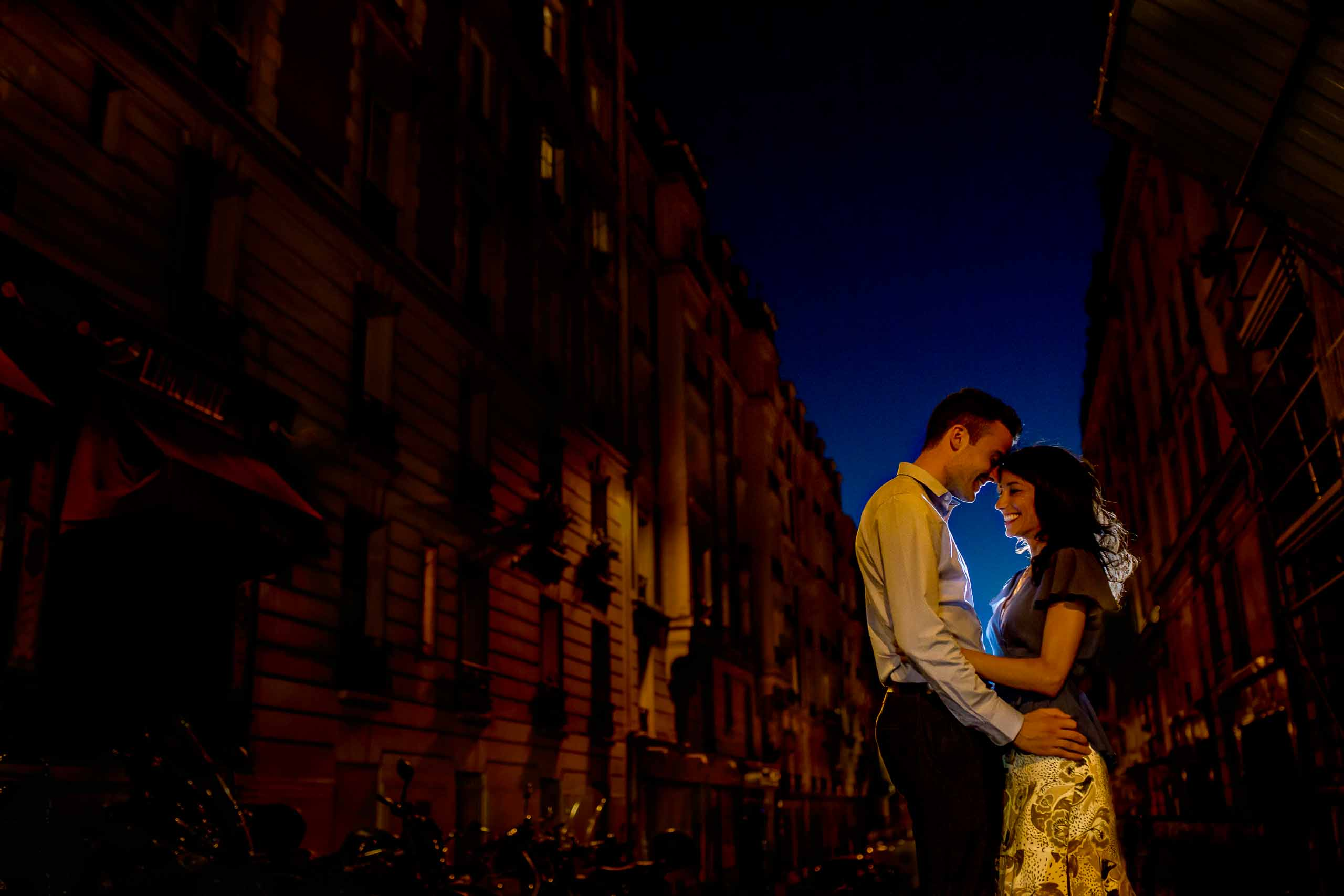 A creative portrait of a couple embracing in back streets during their Paris engagement photo session