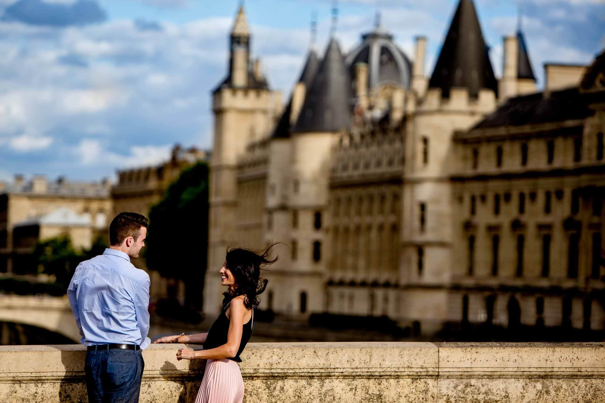 A great atmospheric image of a couple during their Paris engagement photos on Pont Neuf.