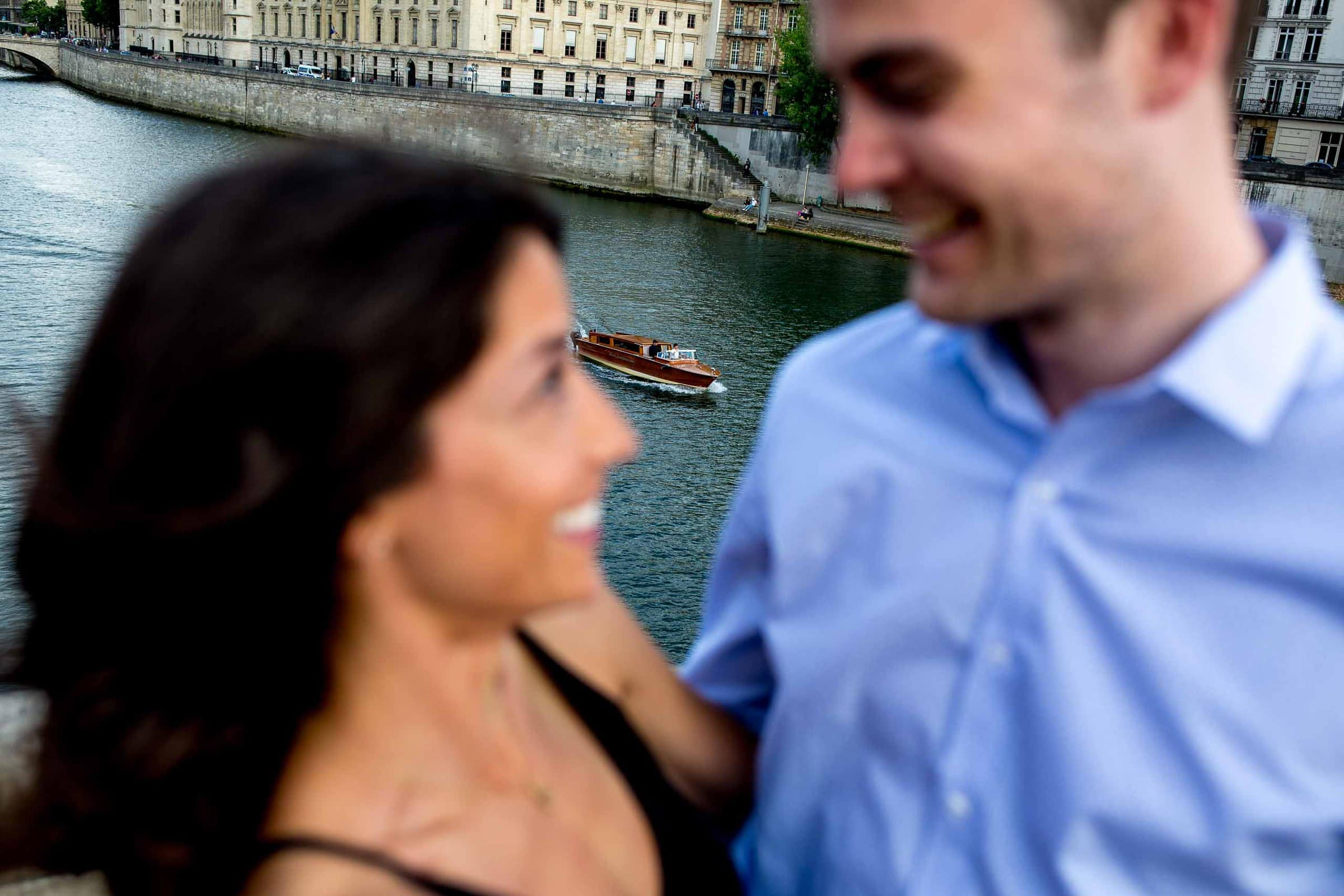 A creative portrait of a couple on Pont Neuf during their Paris engagement photo session