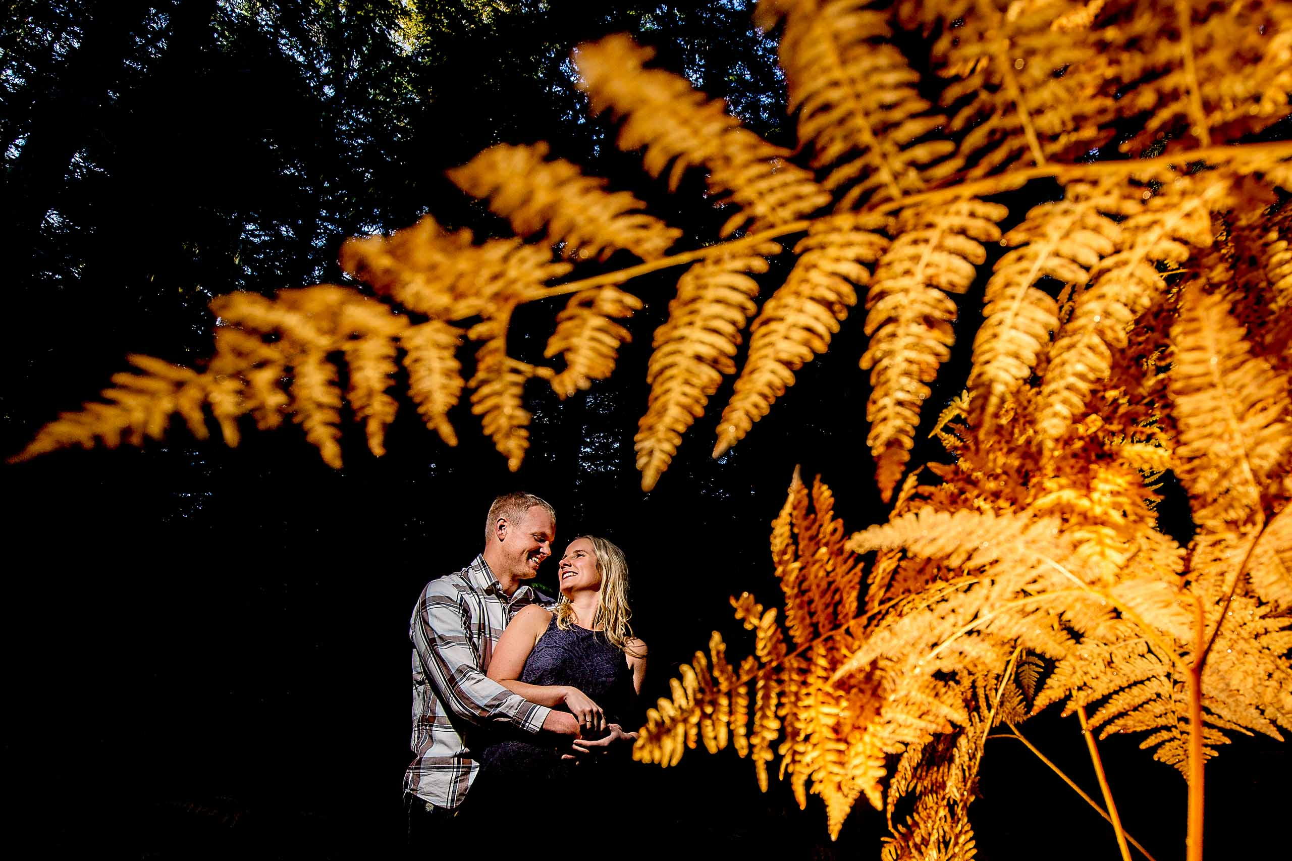 A fun and creative photo of a massive fern for a couples Mt Hood engagement photos