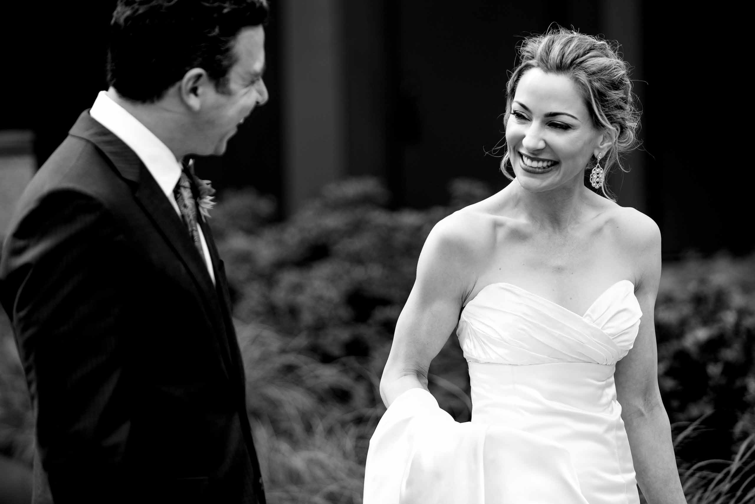 Bride and groom laughing while walking before their EcoTrust wedding in Portland, Oregon