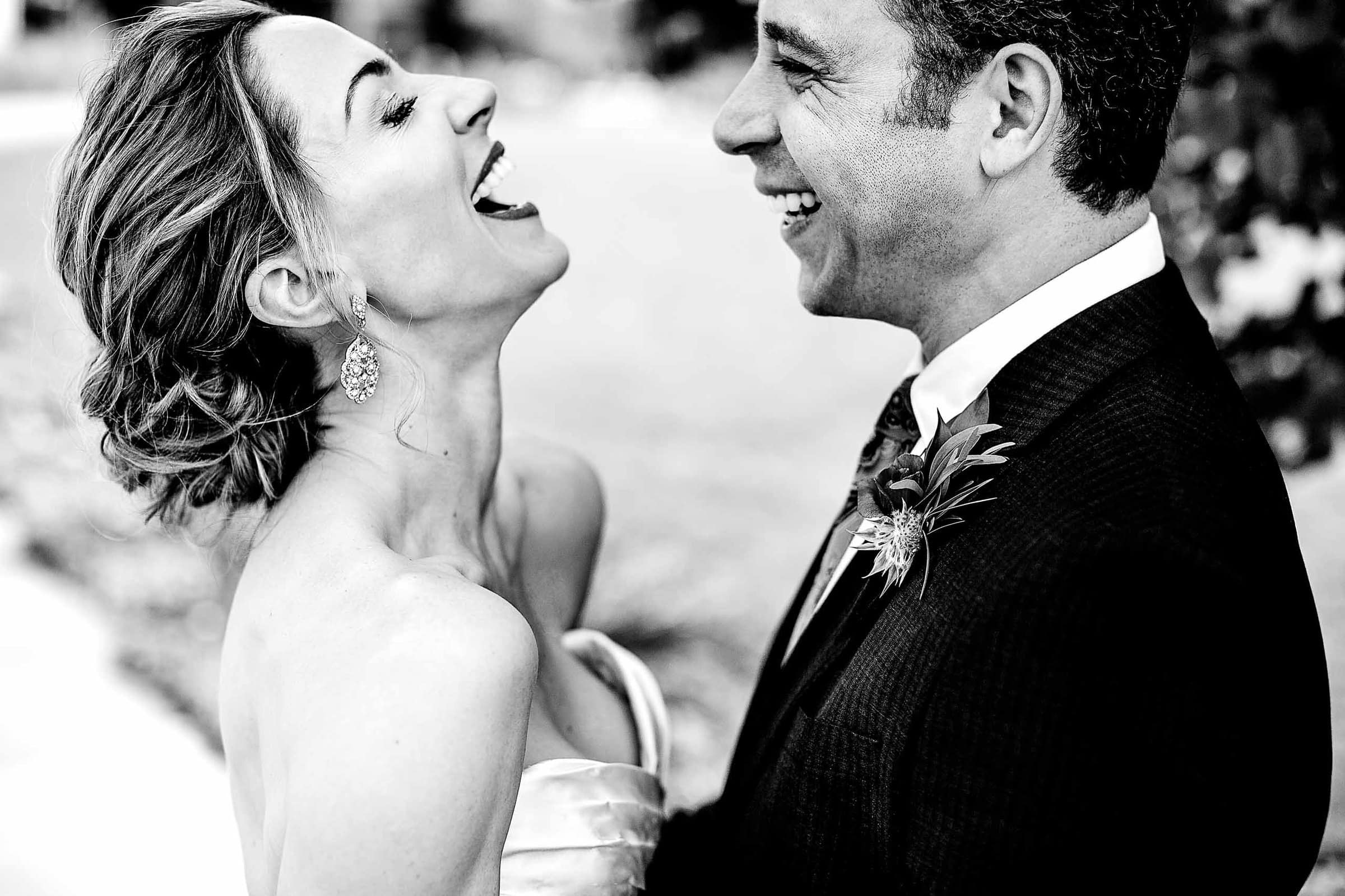 Ecstatic laughter flowing out of bride and groom on their wedding day. Captured just outside Eco Trust Building in Portland's Pearl District. Award winning wedding photos by josandtree
