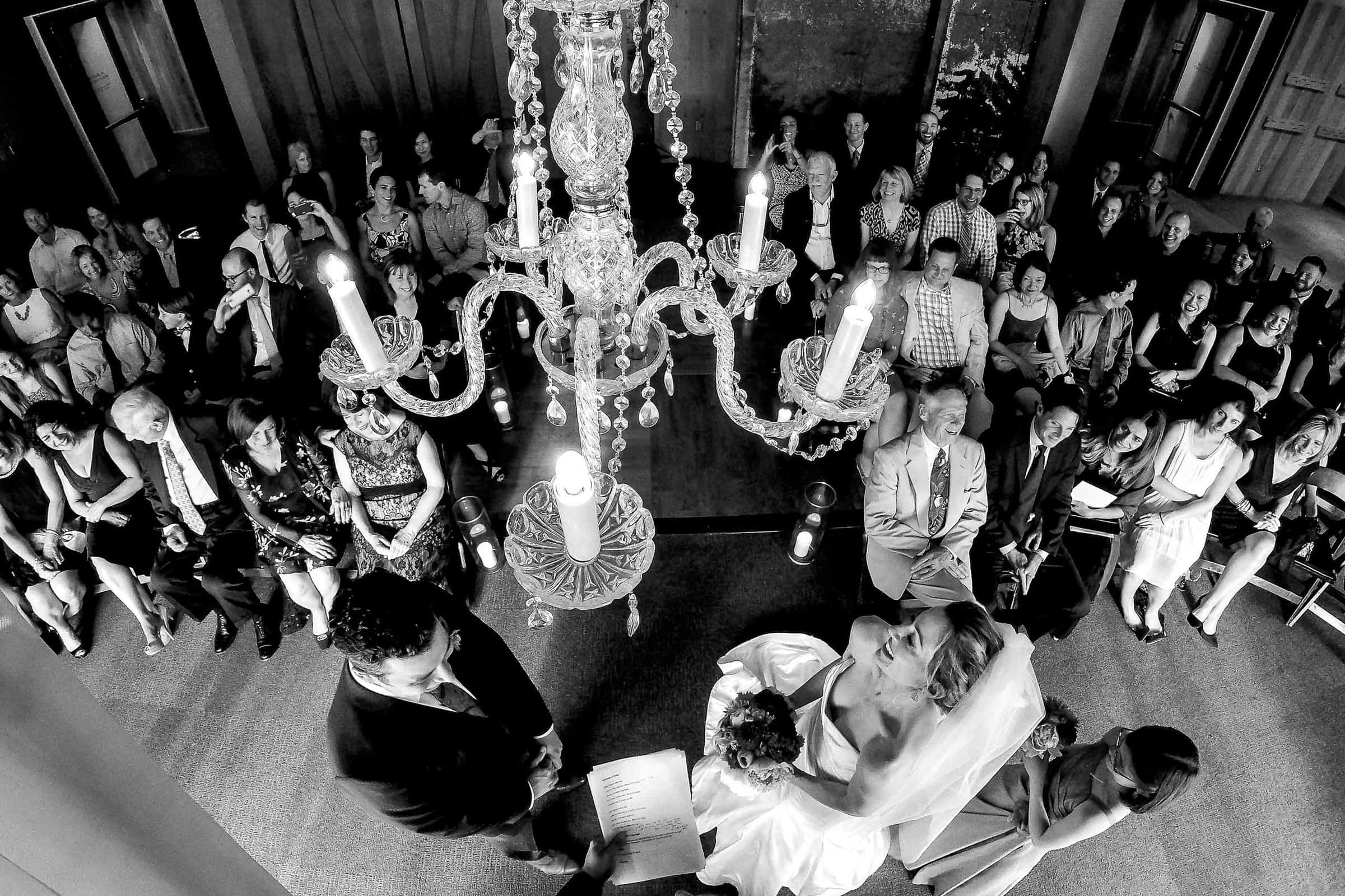 Wide angle photo of Bride and groom during their EcoTrust wedding ceremony in Portland, oregon
