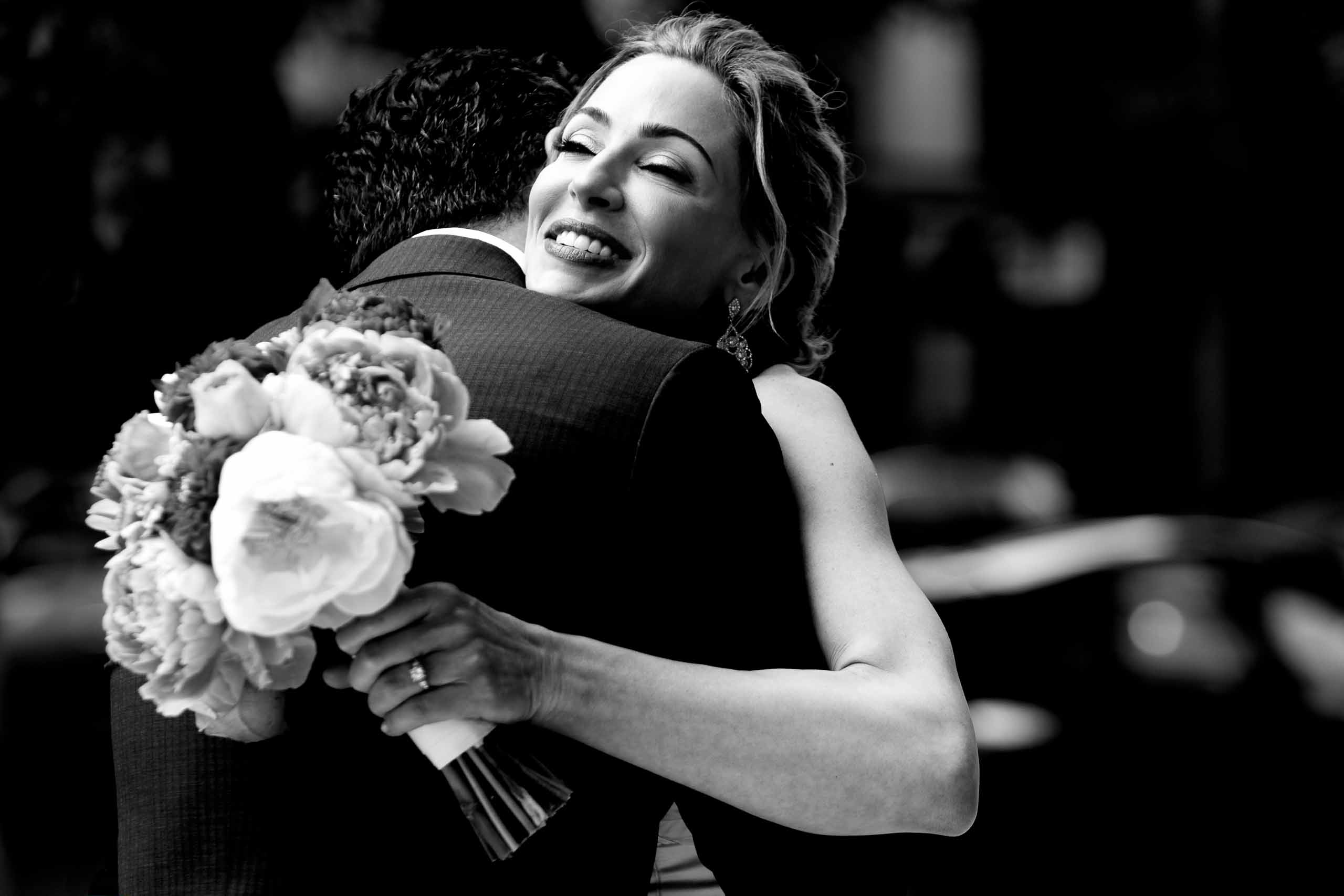 Bride hugging her groom for their EcoTrust wedding in Portland Oregon