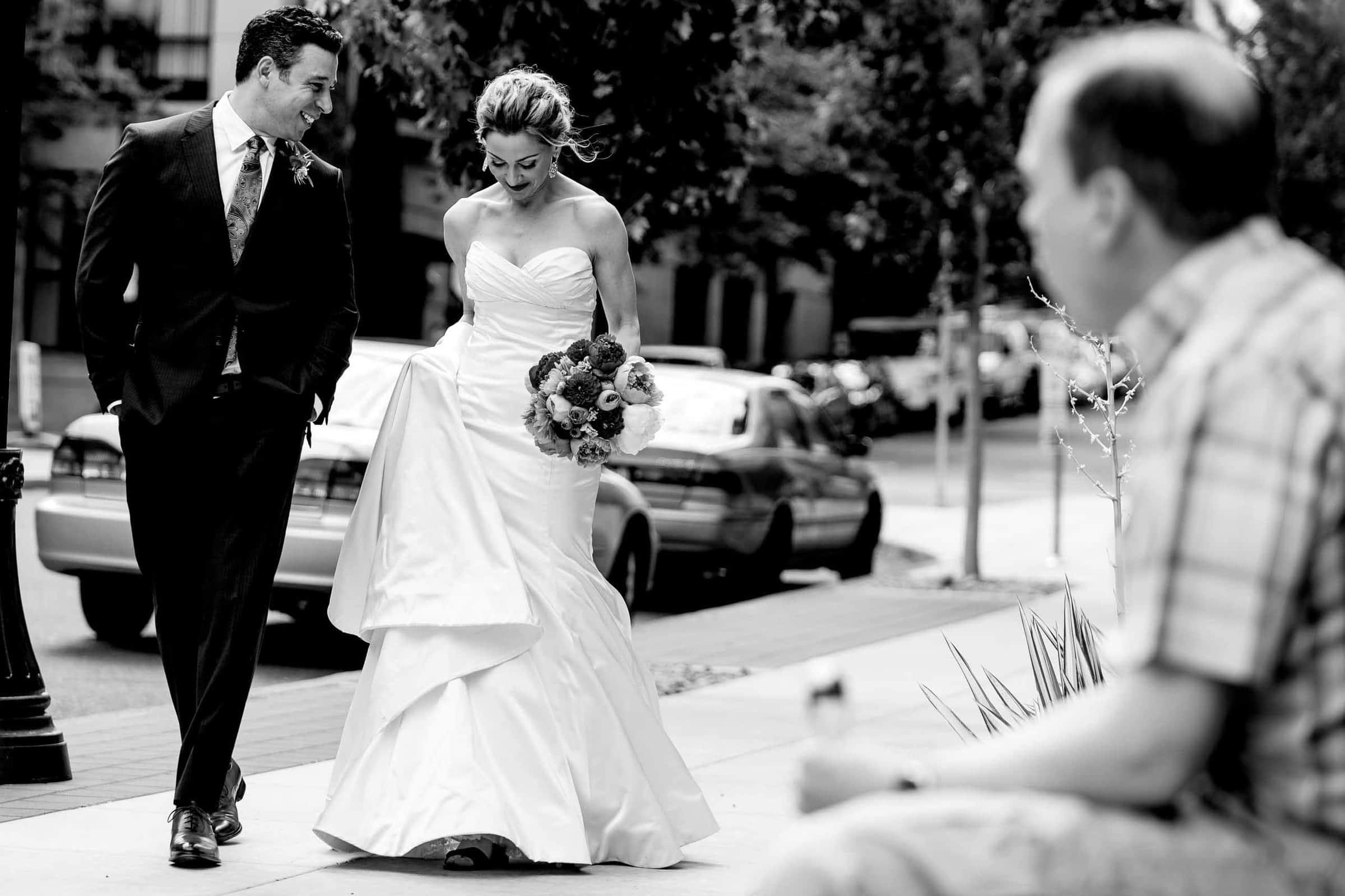 Bride and groom walking in Portland before their EcoTrust wedding.