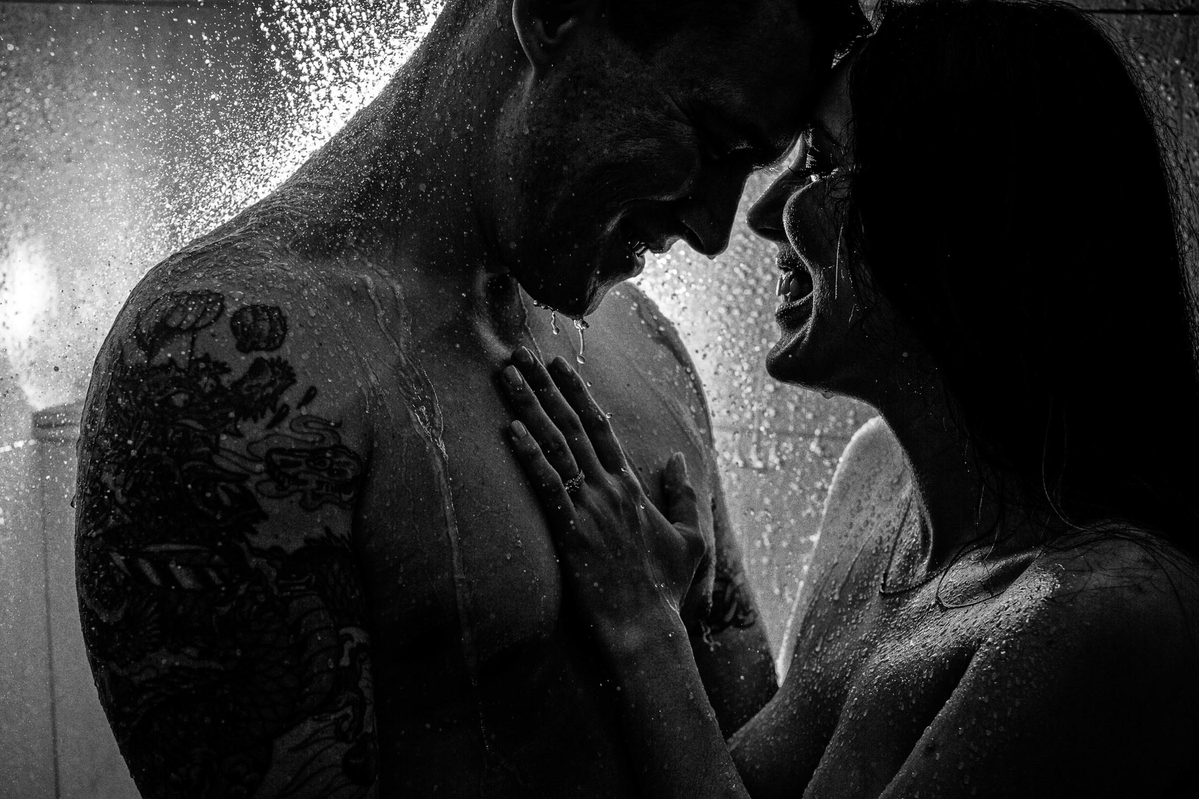 Engagement Couple back lit in shower laughing together for the Portland engagement photos