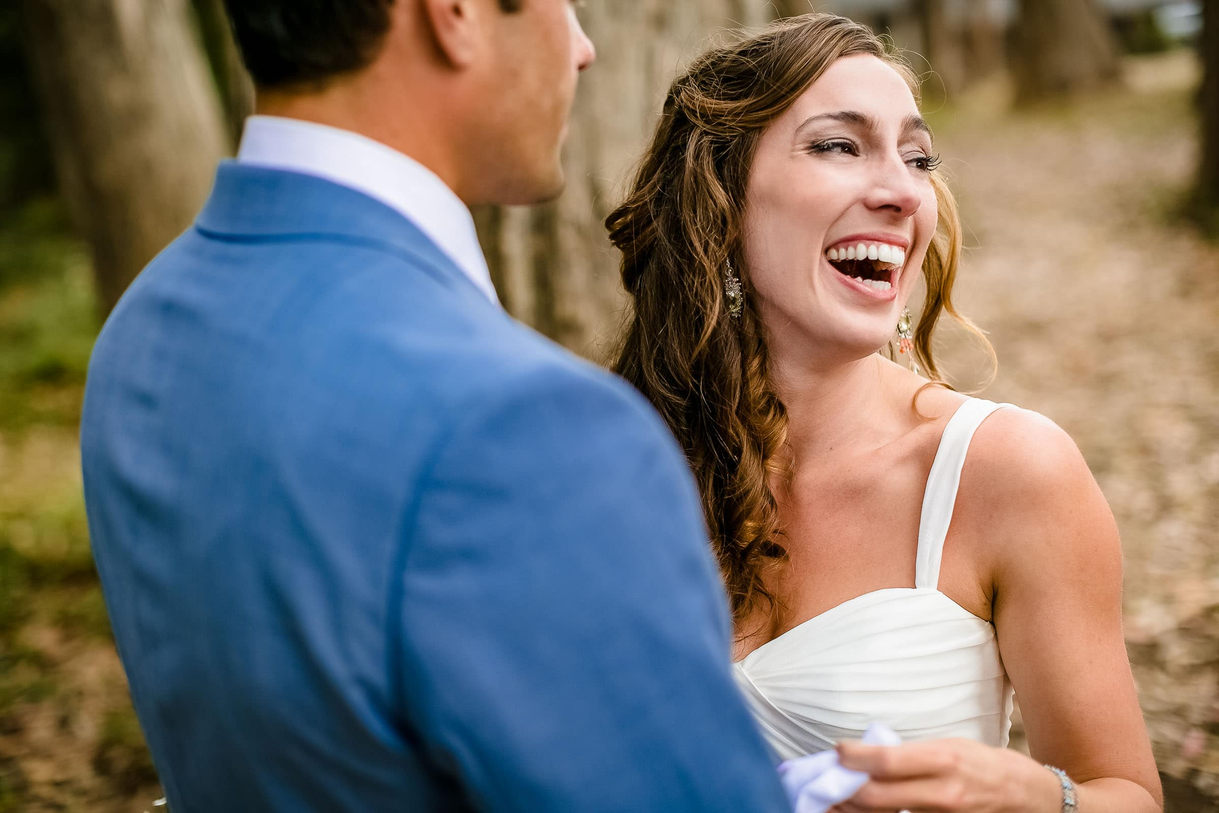 A happy emotional bride seeing her man for the first time for her Mendocino Coast wedding at Spring Ranch