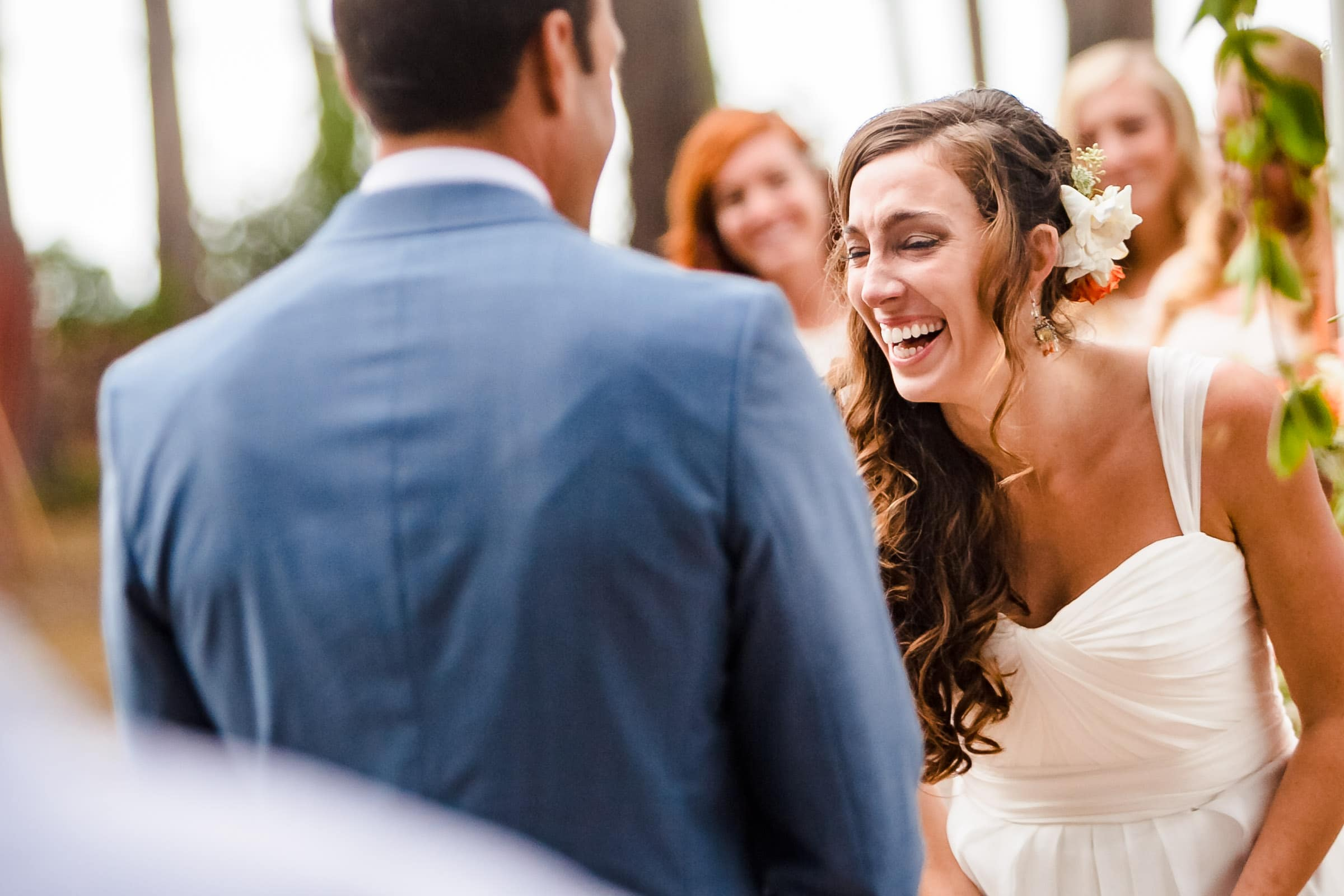 A happy and emotional bride laughing during a Mendocino Coast wedding ceremony at Spring Ranch