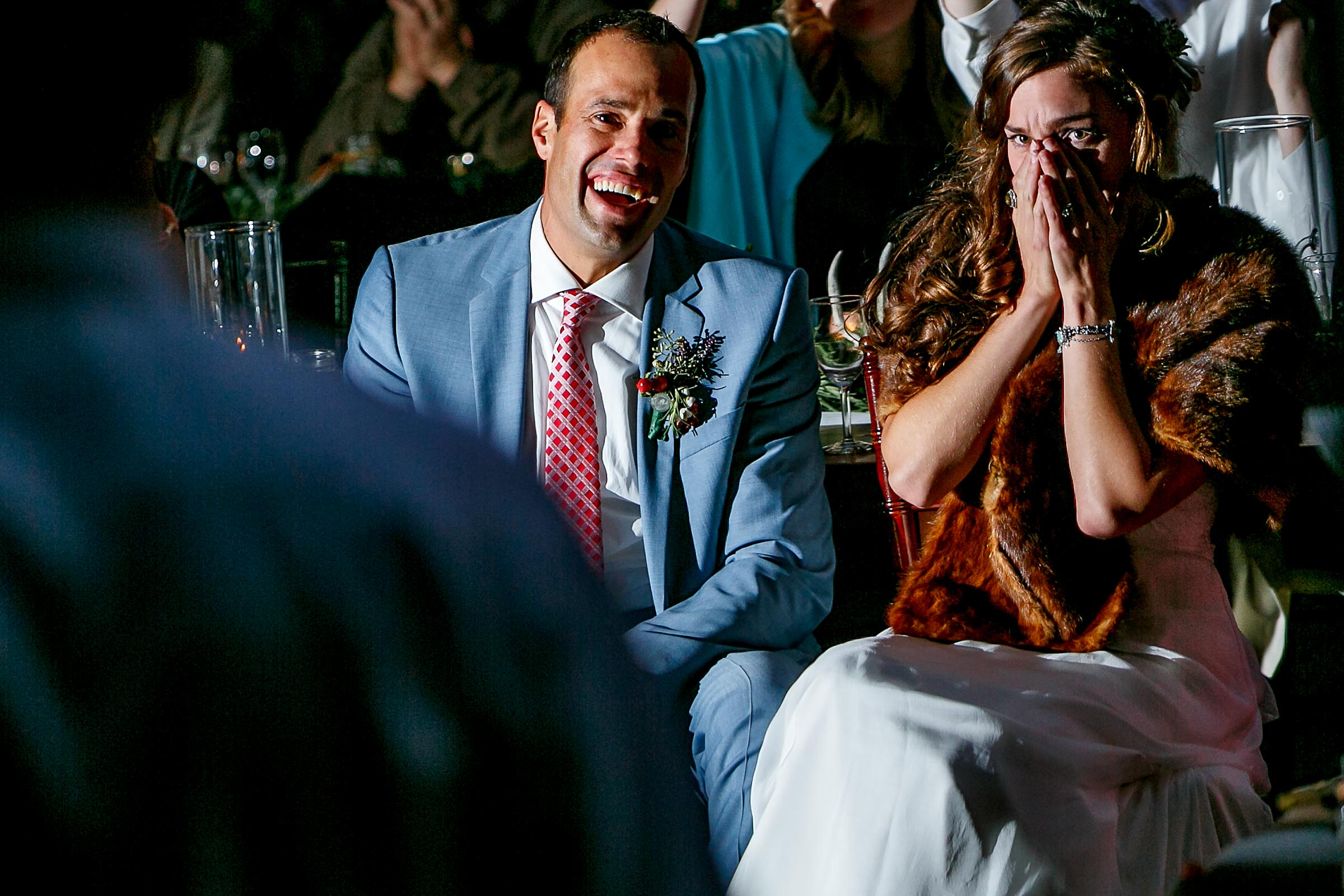 A bride and groom emotional response together from a great best man speech their Mendocino Coast wedding reception at Spring Ranch