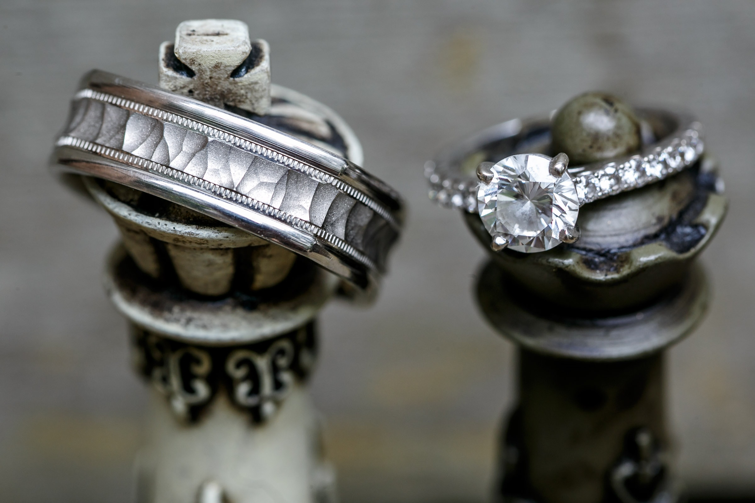 Awesome ring photos of a king and queen pieces from a chess game during a Mendocino Coast wedding at Spring Ranch