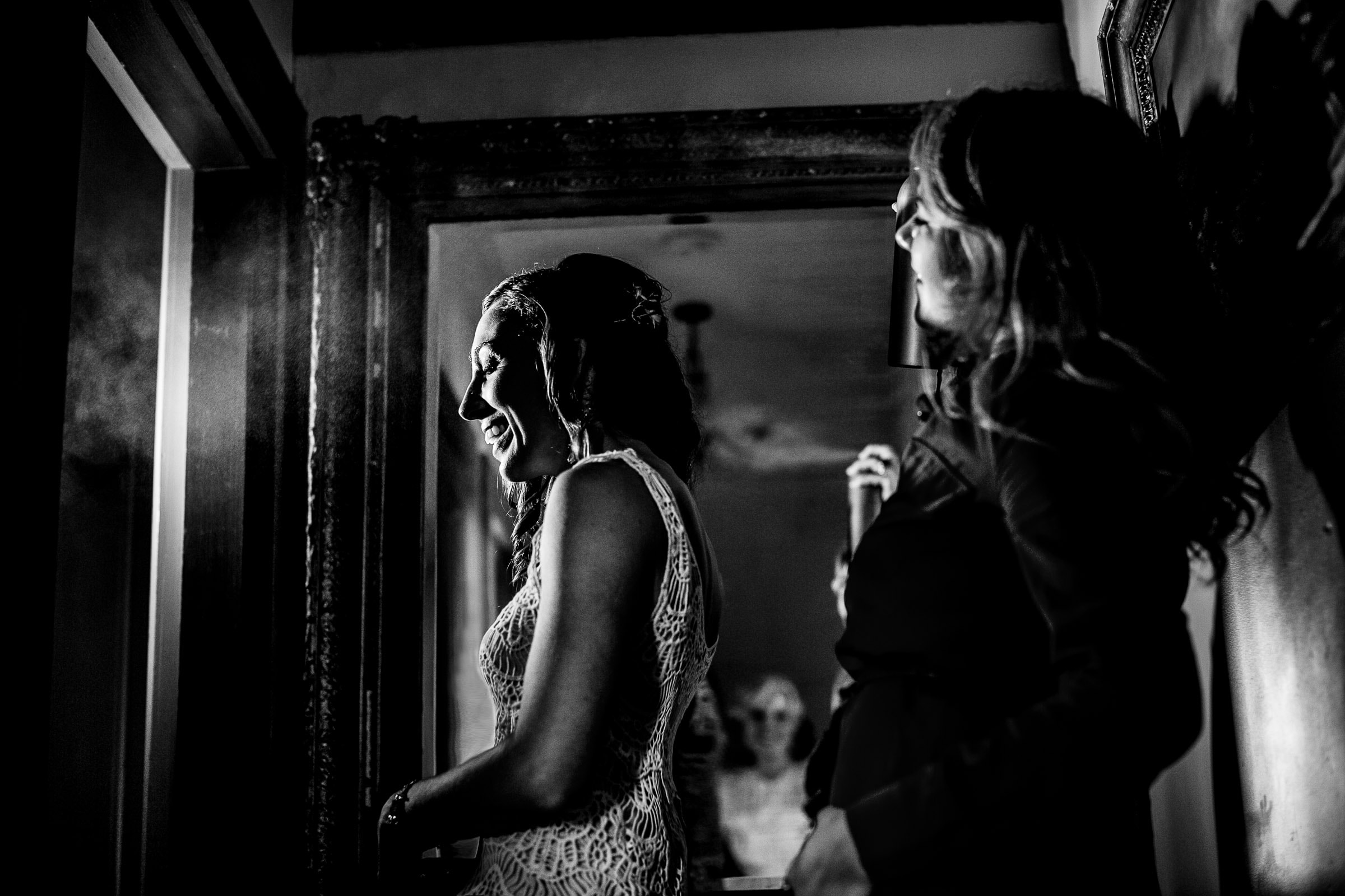 A great black and white photo of a bride getting her hair done for her Mendocino Coast wedding at Spring Ranch