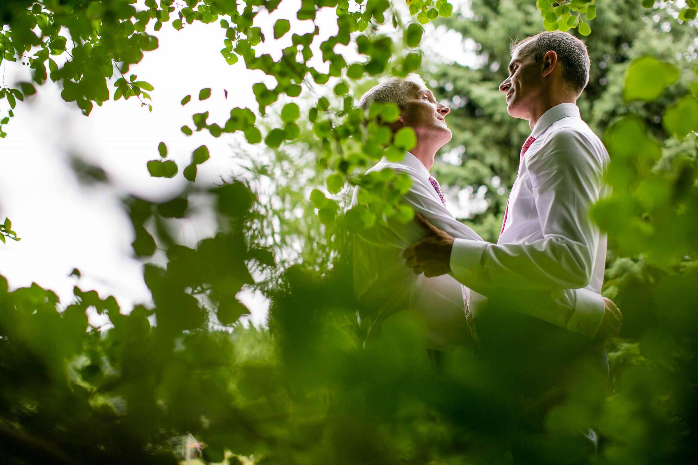 Two grooms looking into each other moments before their Mt Hood Organic Farms Wedding