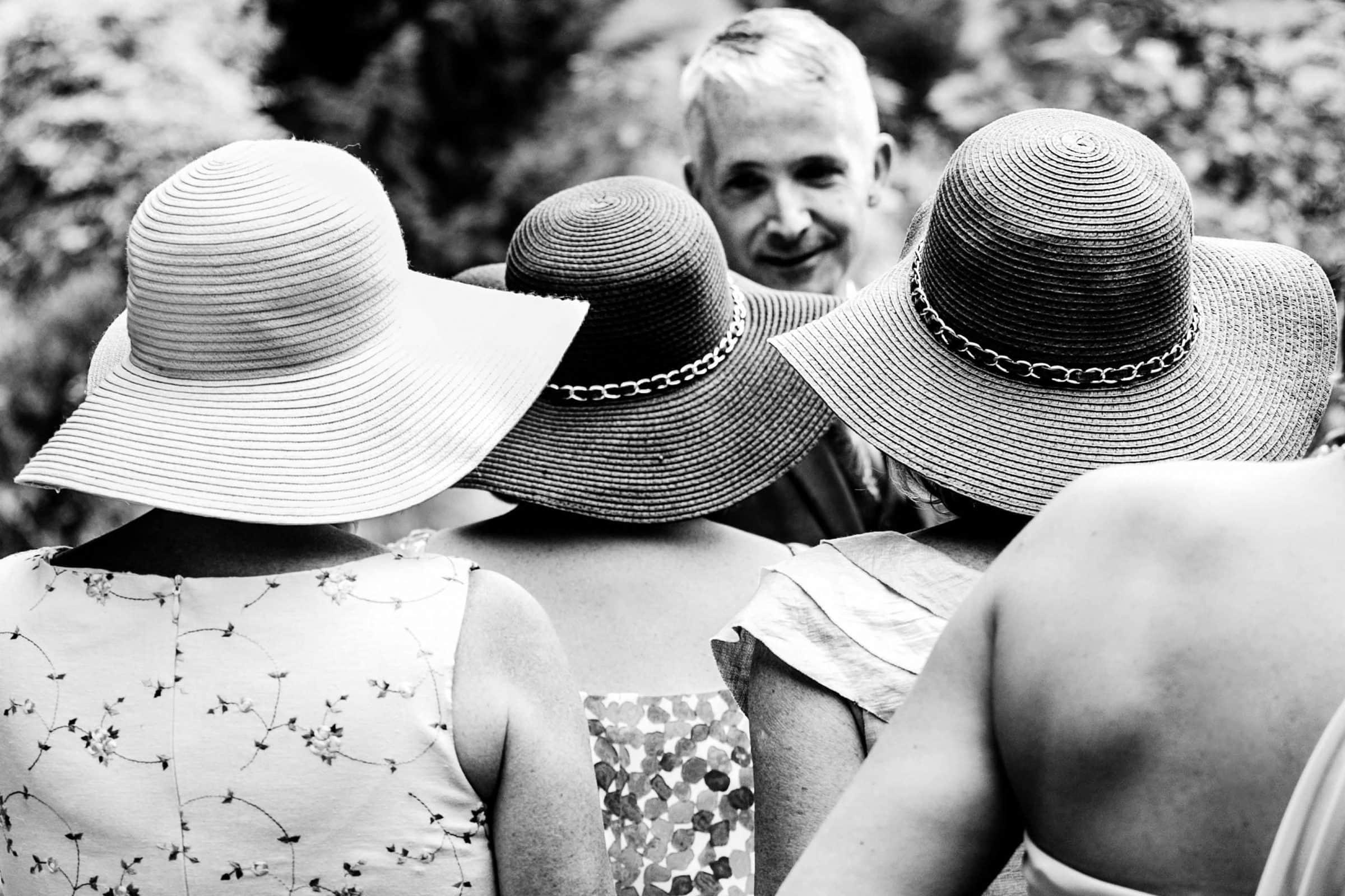 Fun sun hats during a Mt Hood Organic Farms Wedding ceremony just outside Hood River, Oregon
