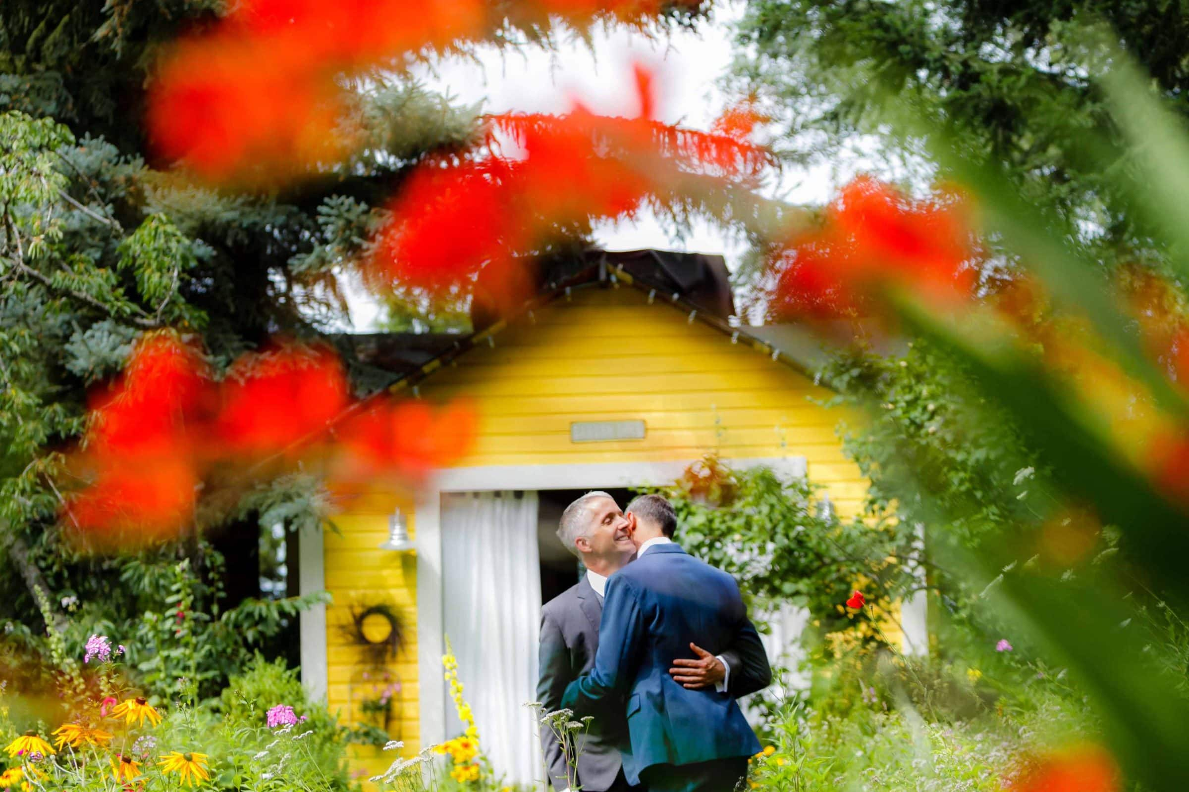 Two grooms embracing during their Mt Hood Organic Farms Wedding