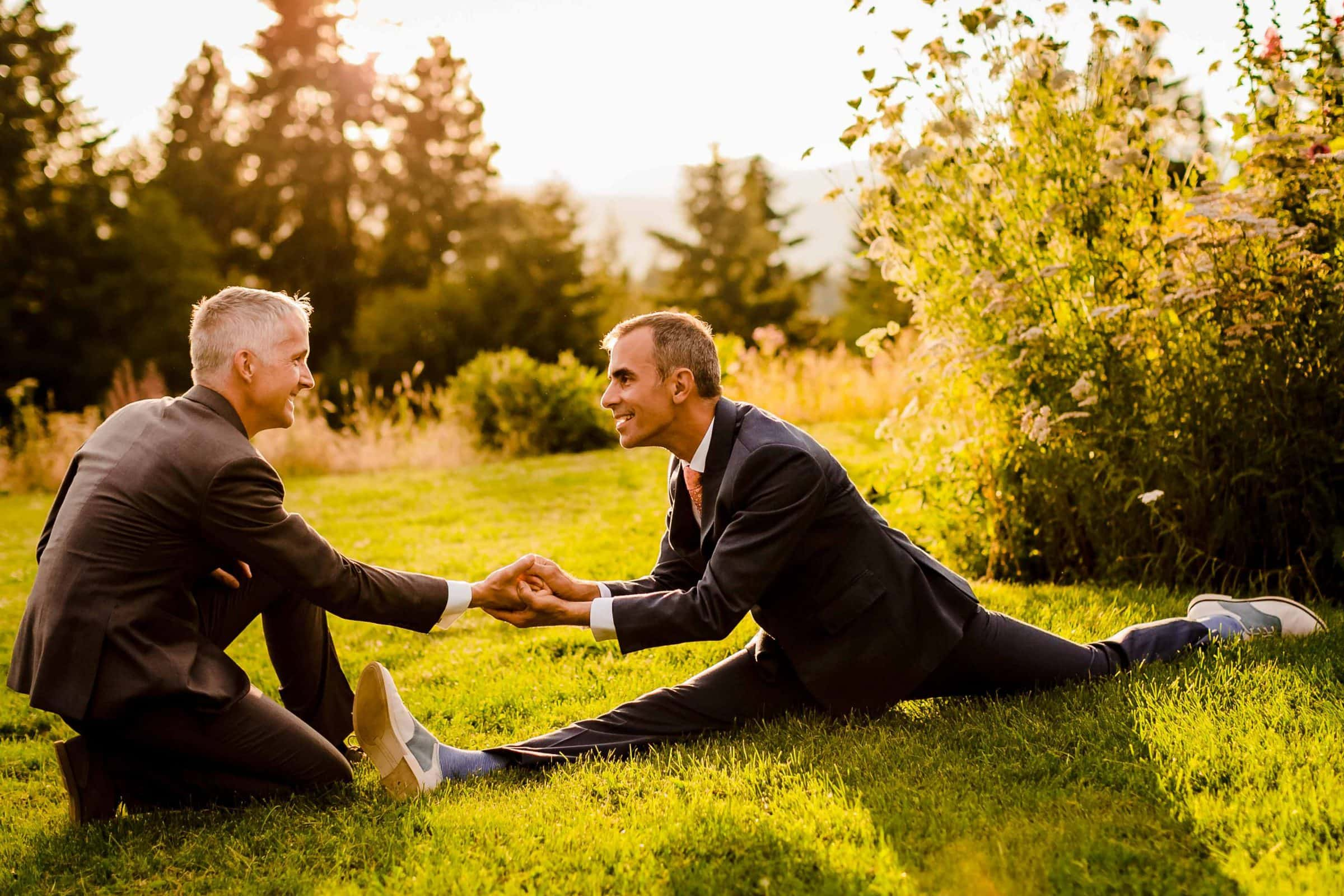 Fun photo of a groom and groom doing the splits during their Mt Hood Organic Farms Wedding reception just outside Hood River, Oregon