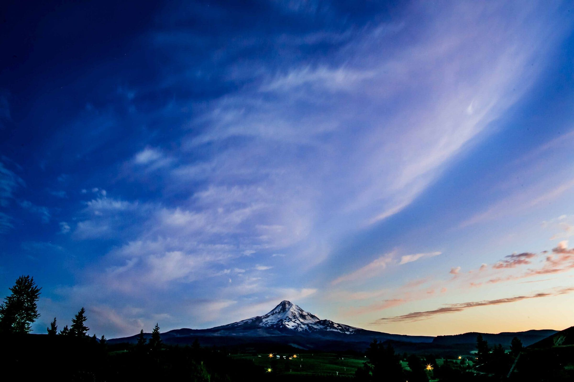 A beautiful wide angle photo of the sky with the mountain during a Mt Hood Organic Farms Wedding reception just outside Hood River, Oregon