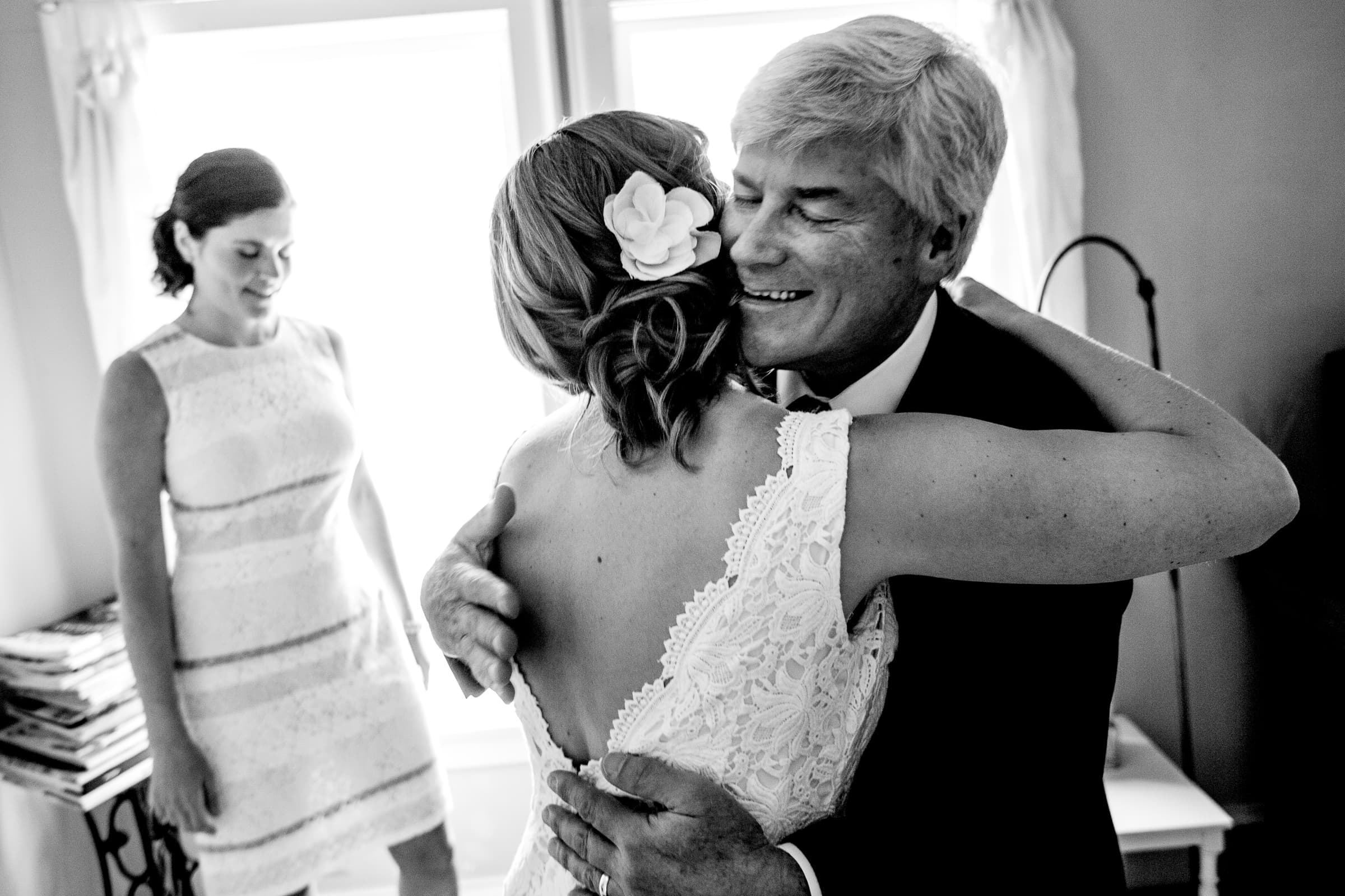 Bride hugging her father before her Mt Hood Organic Farms Wedding ceremony