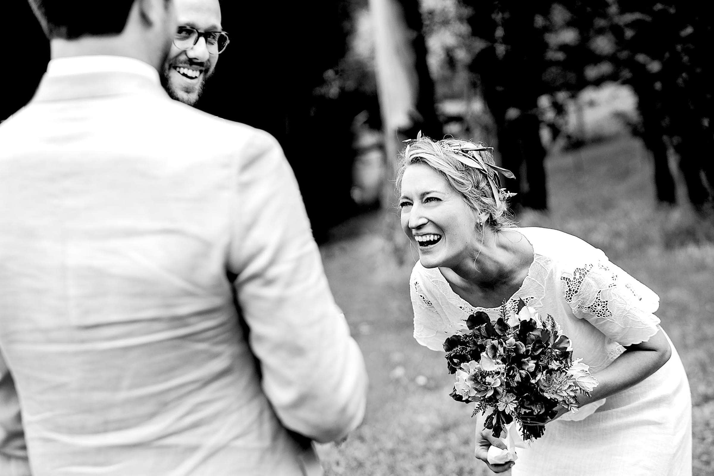 Bride laughing and crying during a Sonoma wine country wedding ceremony