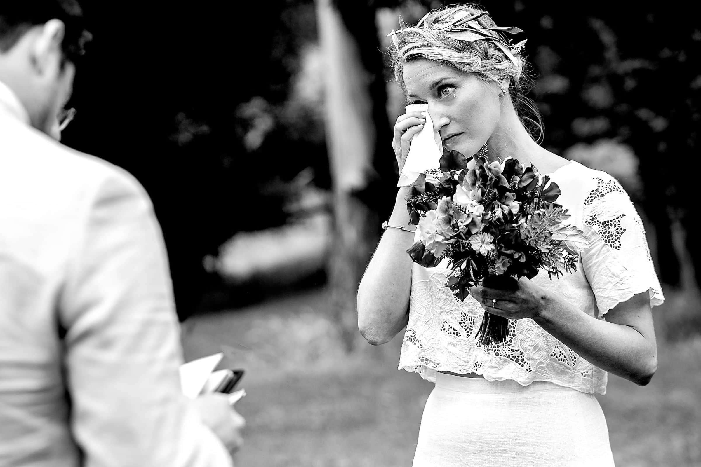 Emotional bride crying with a tear during a Sonoma wine country wedding ceremony