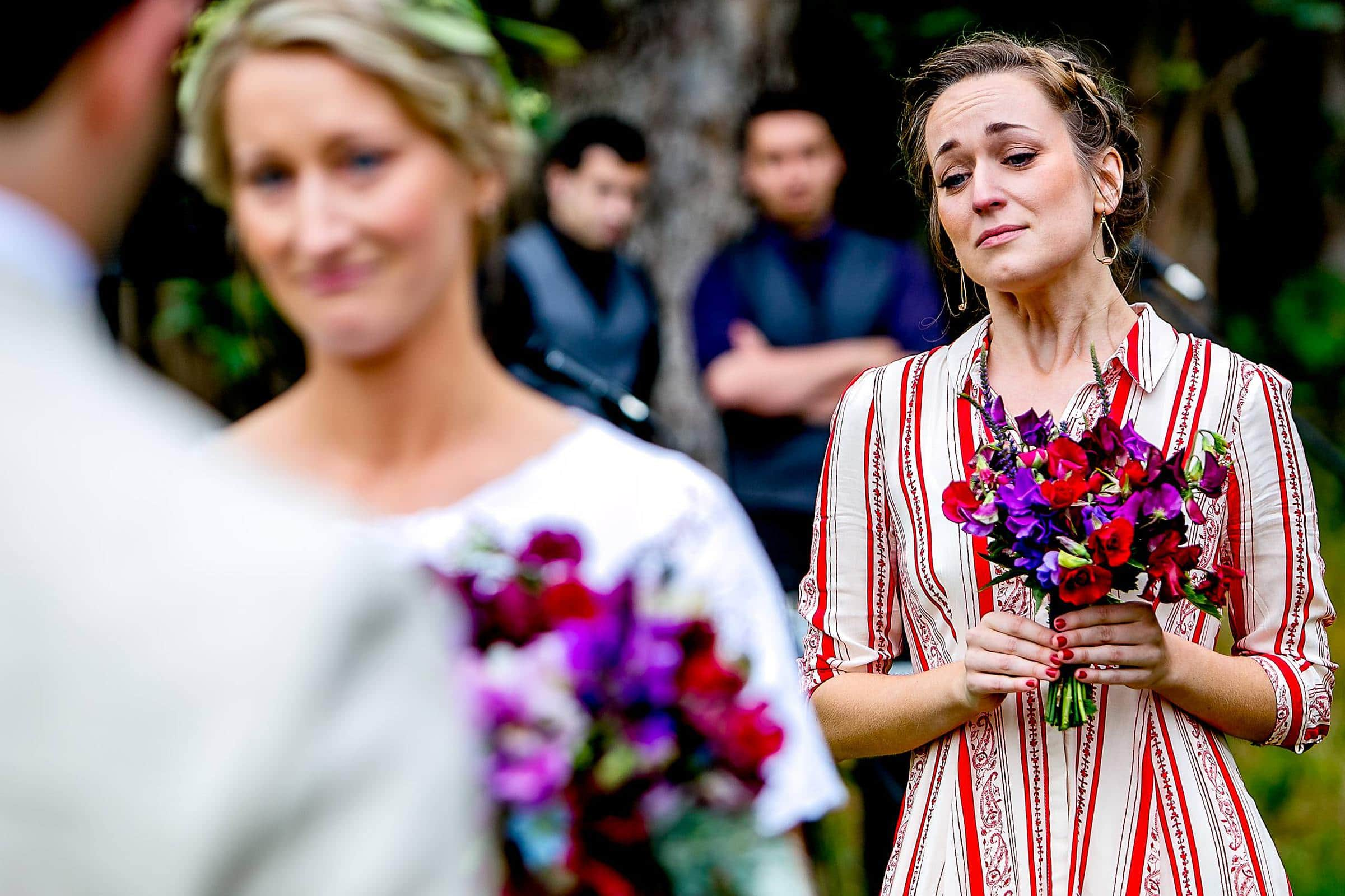 Emotional bridesmaid during a Sonoma wine country wedding ceremony