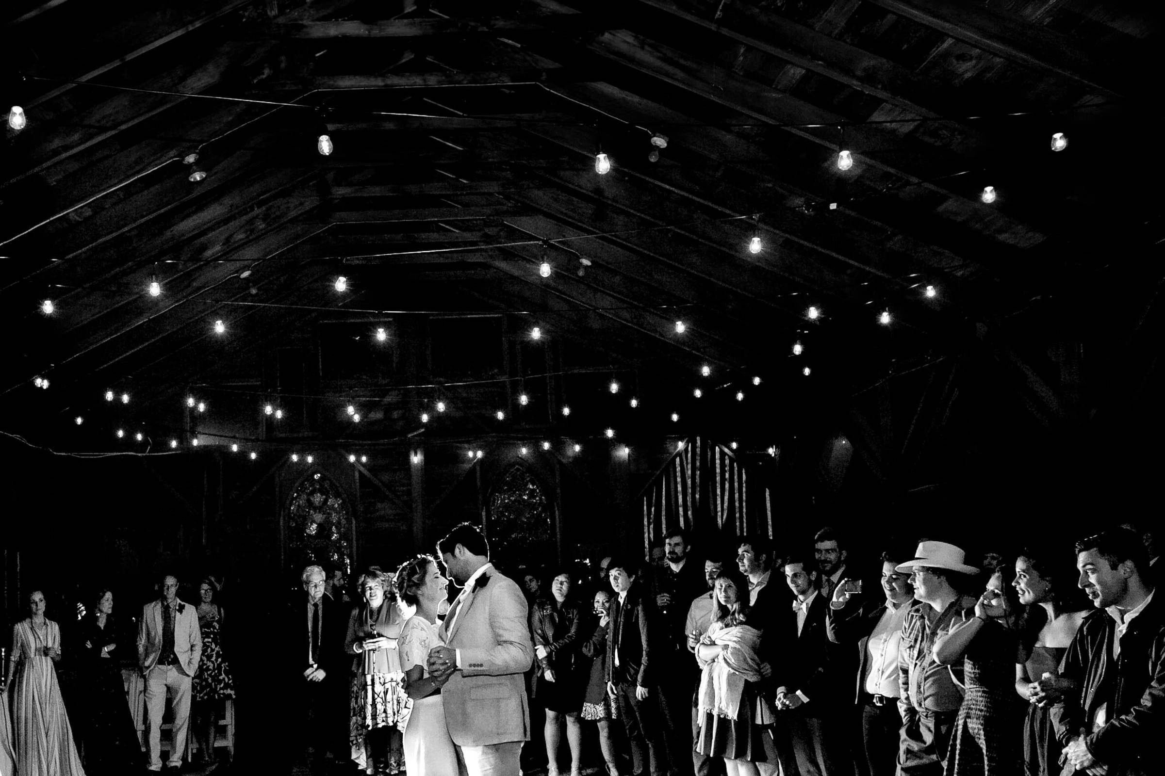 Bride and groom first dance in a Grateful Dead barn during a Sonoma wine country wedding reception