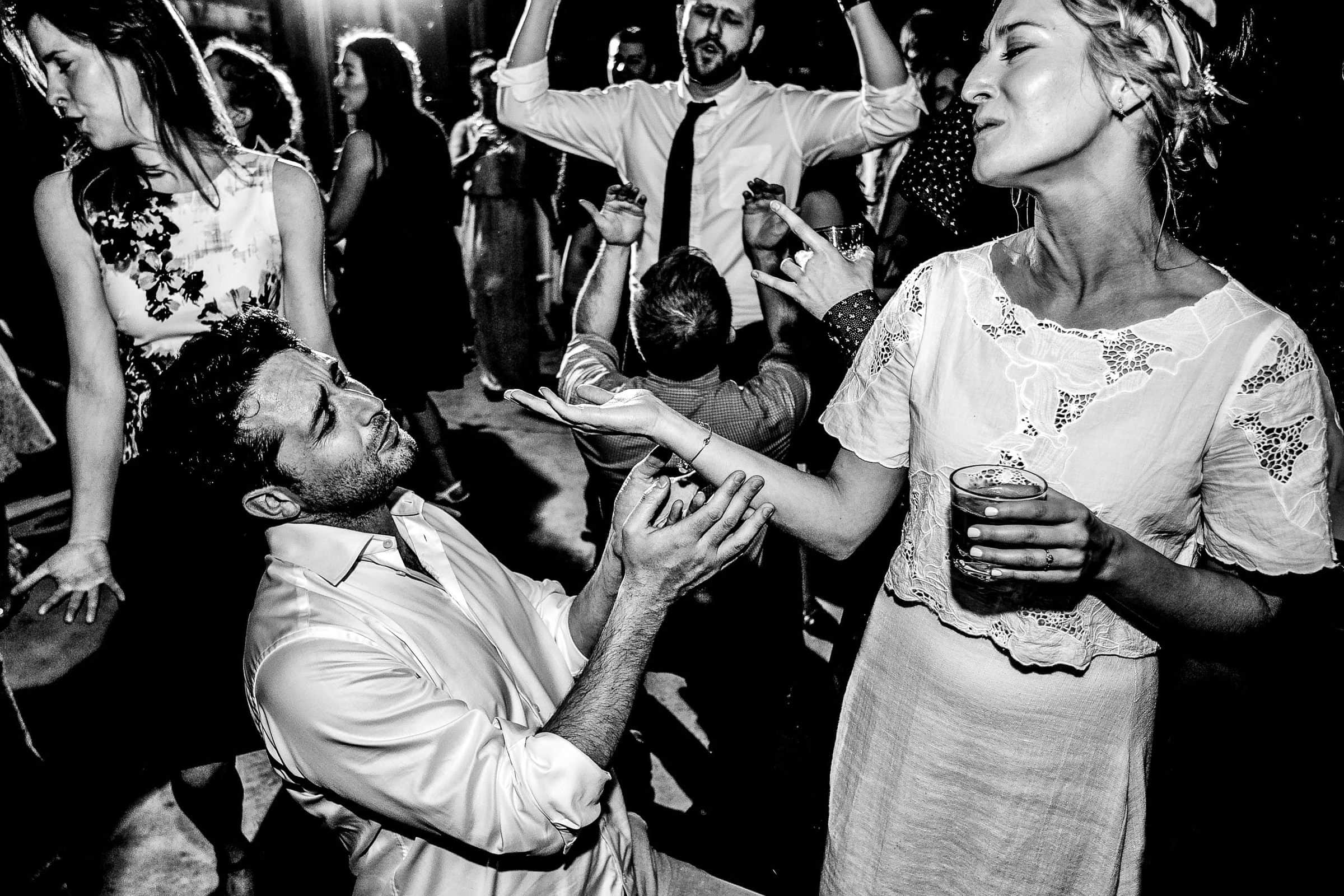 Groom and bride dancing fun in a Grateful Dead barn during a Sonoma wine country wedding reception