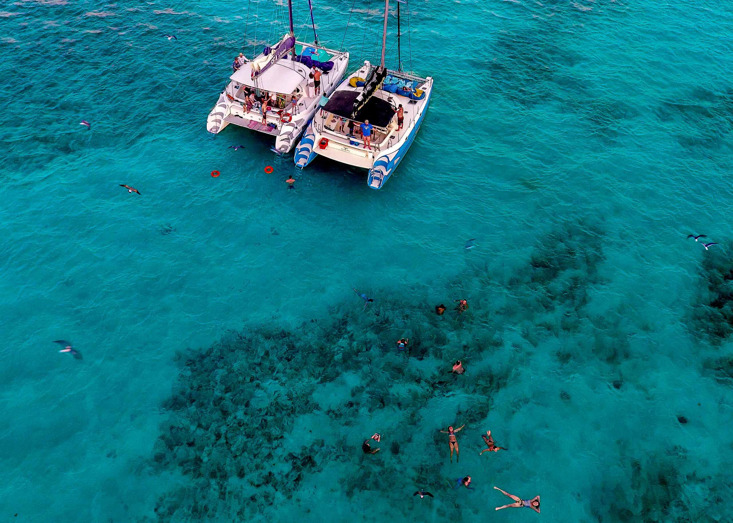 Nikki and Paul on a catamaran cruise the day before their Portofino Beach Resort Wedding in Belize