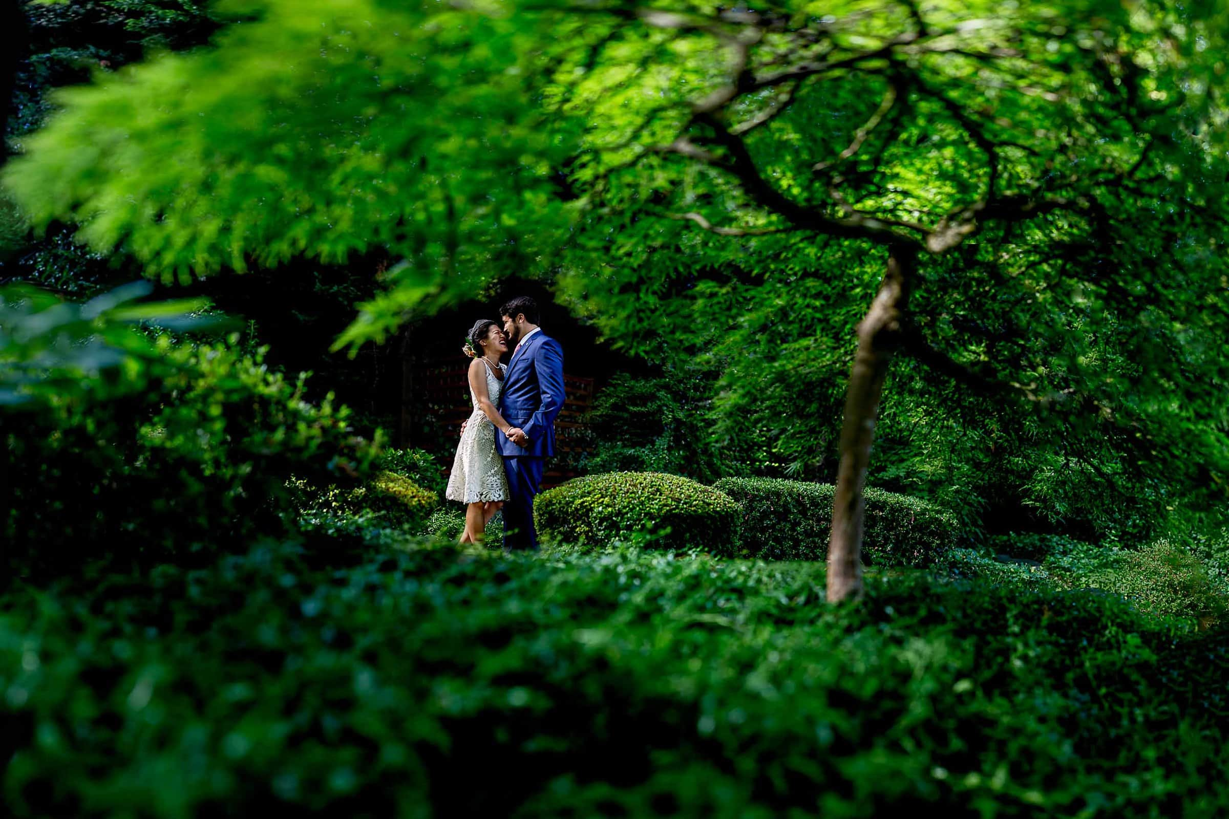 Bride and groom portrait in their goregous yard with beautiful trees during their private Seattle elopement