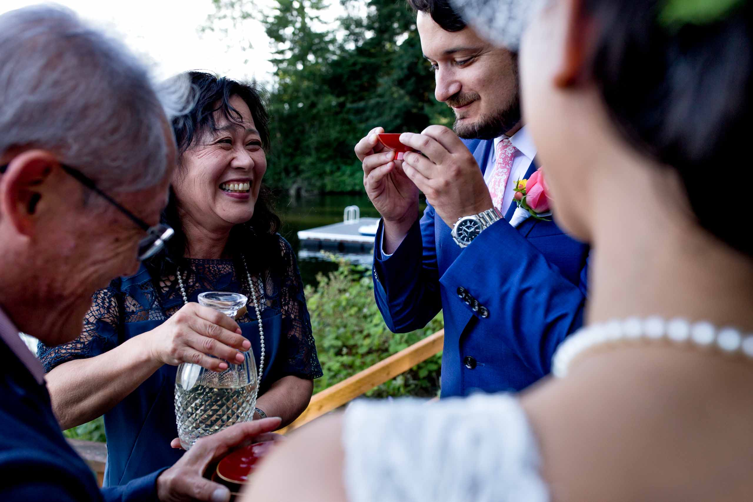 Bride and Groom exchanging tea ceremony during a private Seattle elopement ceremony