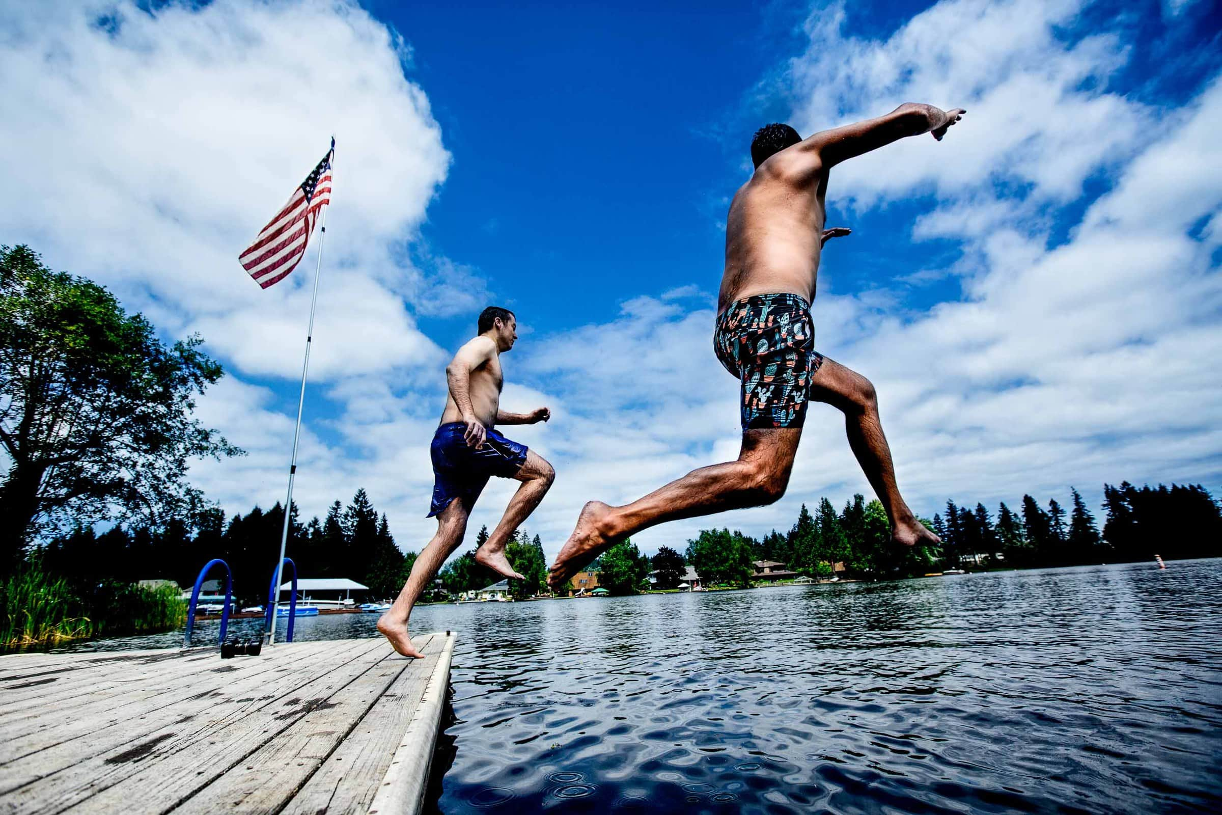 Groom jumping into water with his best man before his Seattle elopement