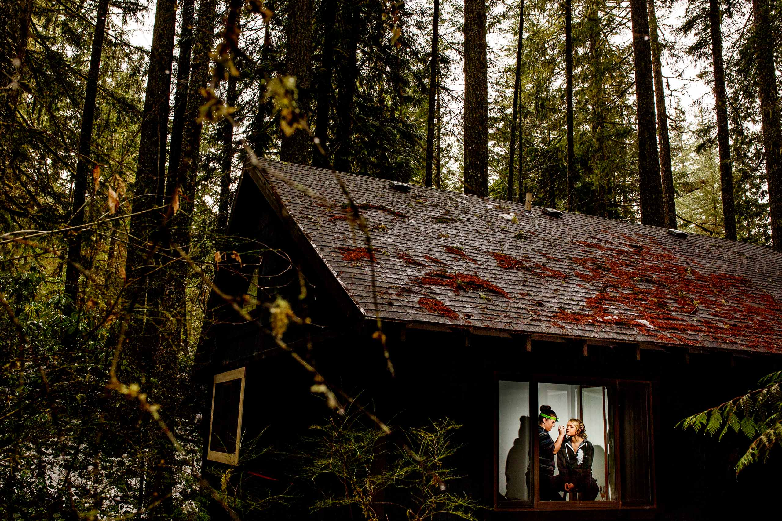 Bride getting ready at a cabin in Government camp for her Silcox Hut Wedding atop Mt Hood.