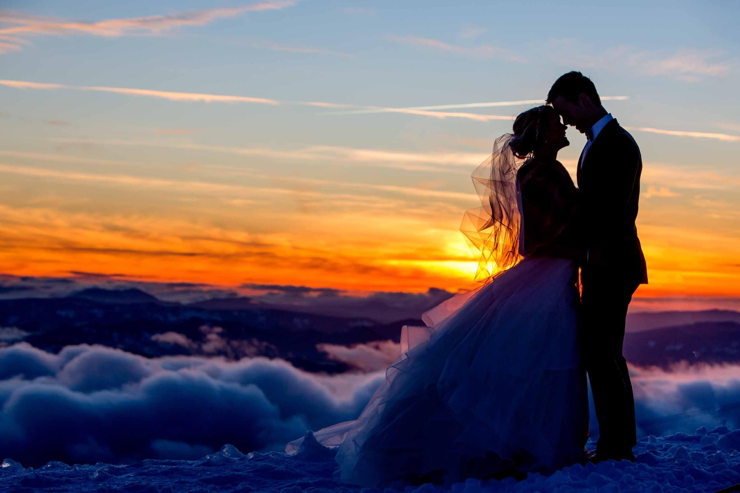 Bride and groom portrait atop Mt Hood at sunset for their Silcox Hut wedding