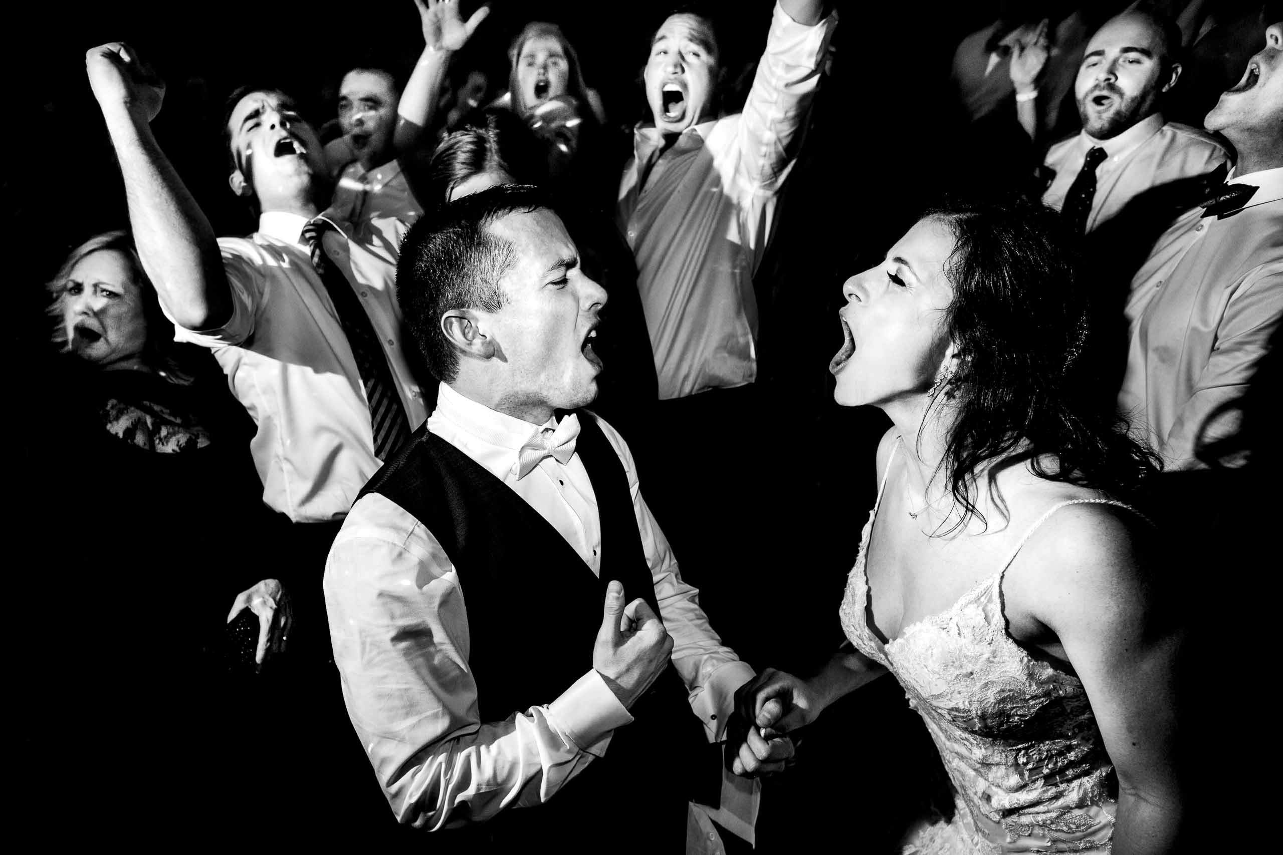 Super fun photo of a bride and groom singing and dancing during their Sunriver Resort wedding reception in Oregon