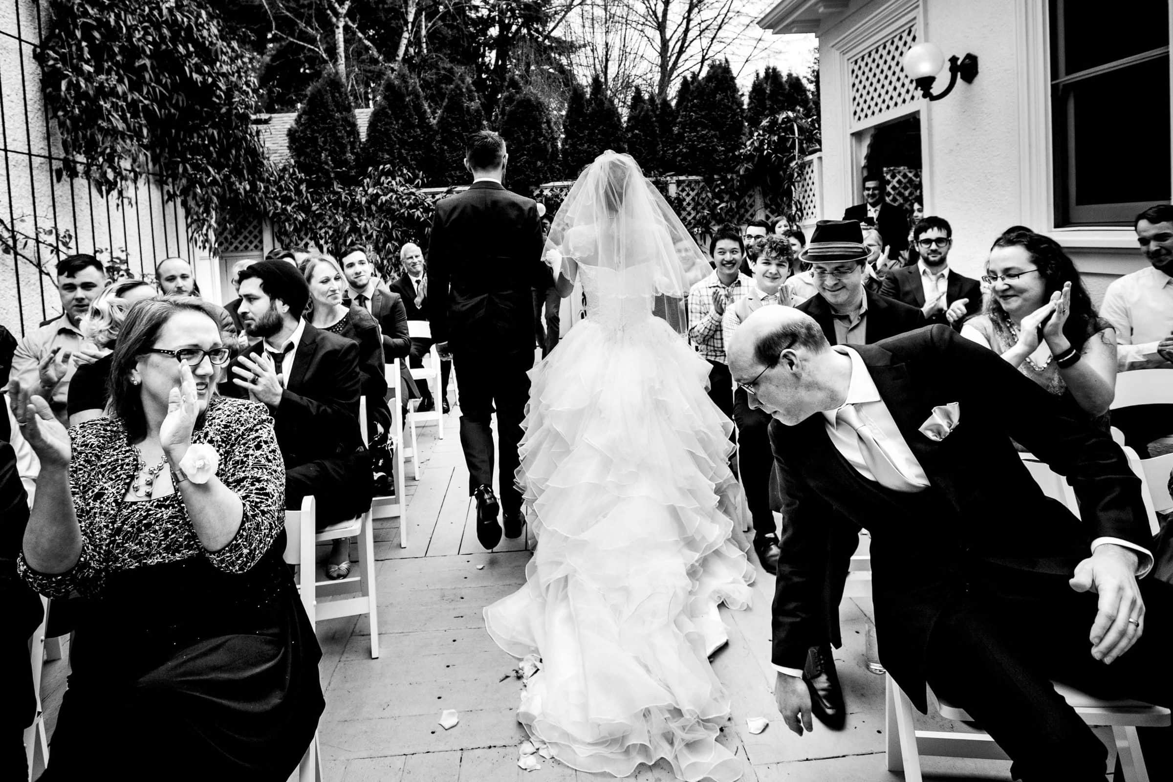 Bride and groom exiting other during their Portland White House wedding ceremony