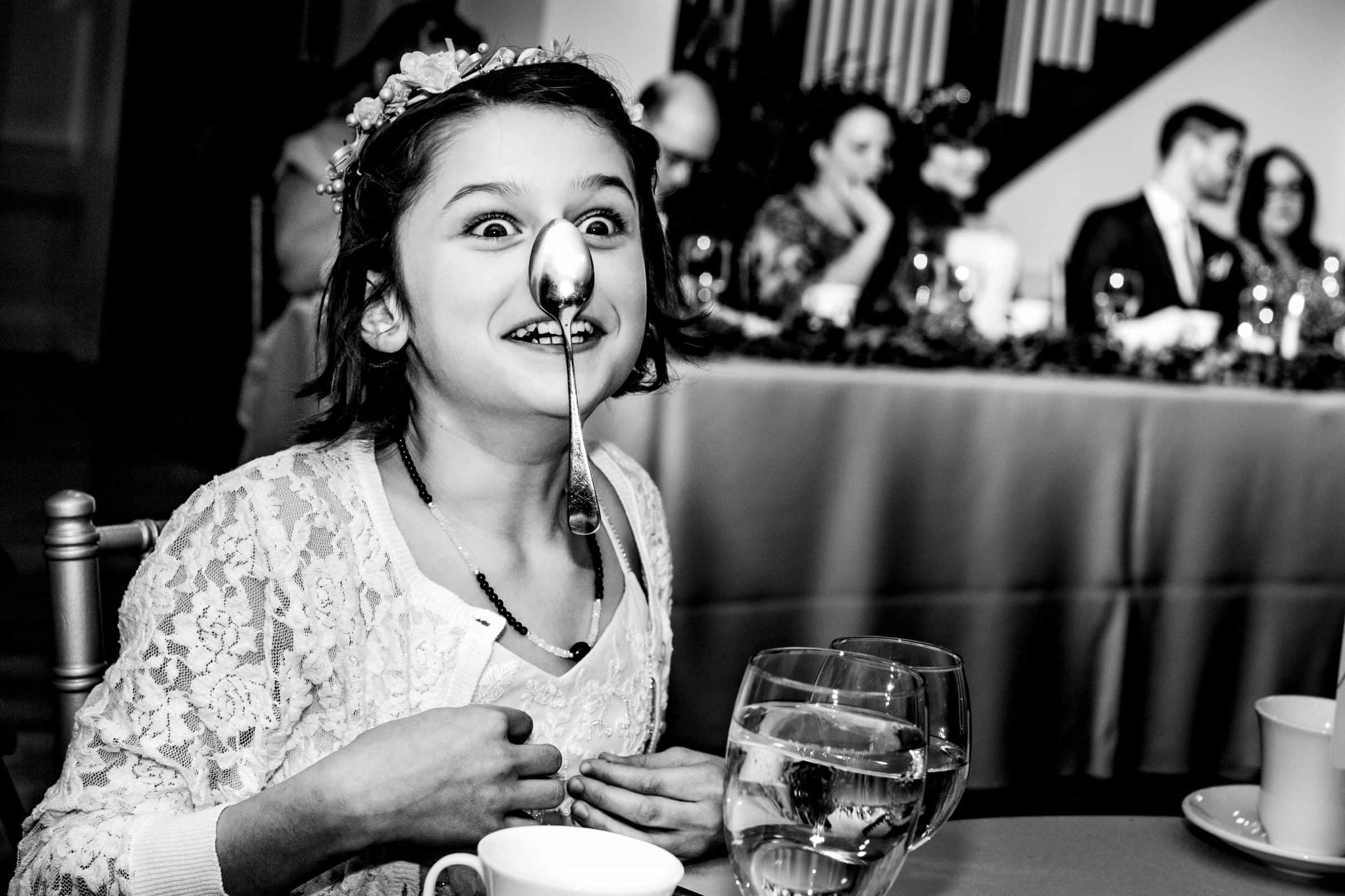 Funny wedding photo of girl at a reception at Portland White House wedding.