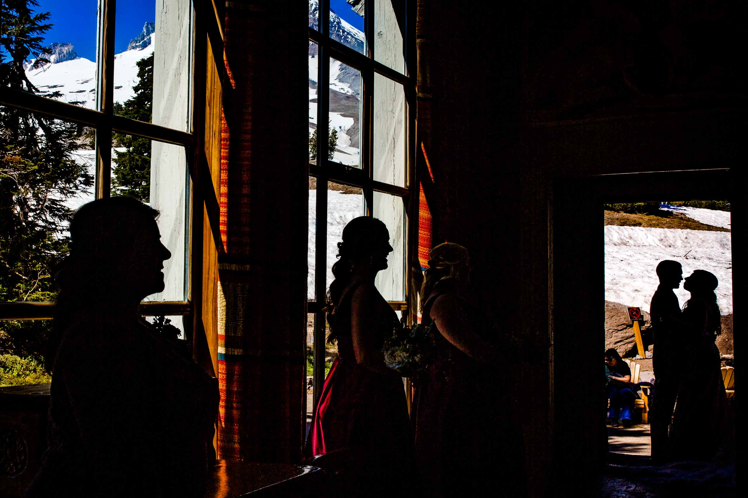 Silhouettes of bride and groom moments before their Timberline Lodge Wedding ceremony