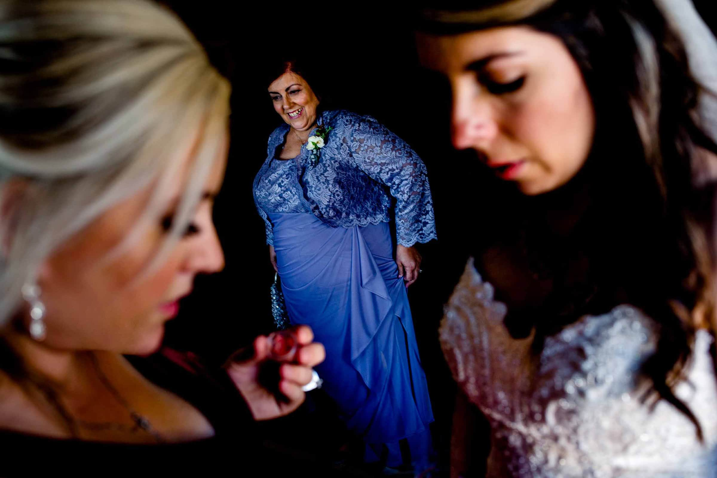 Bride getting ready with friends and mother before her Timberline Lodge Wedding ceremony