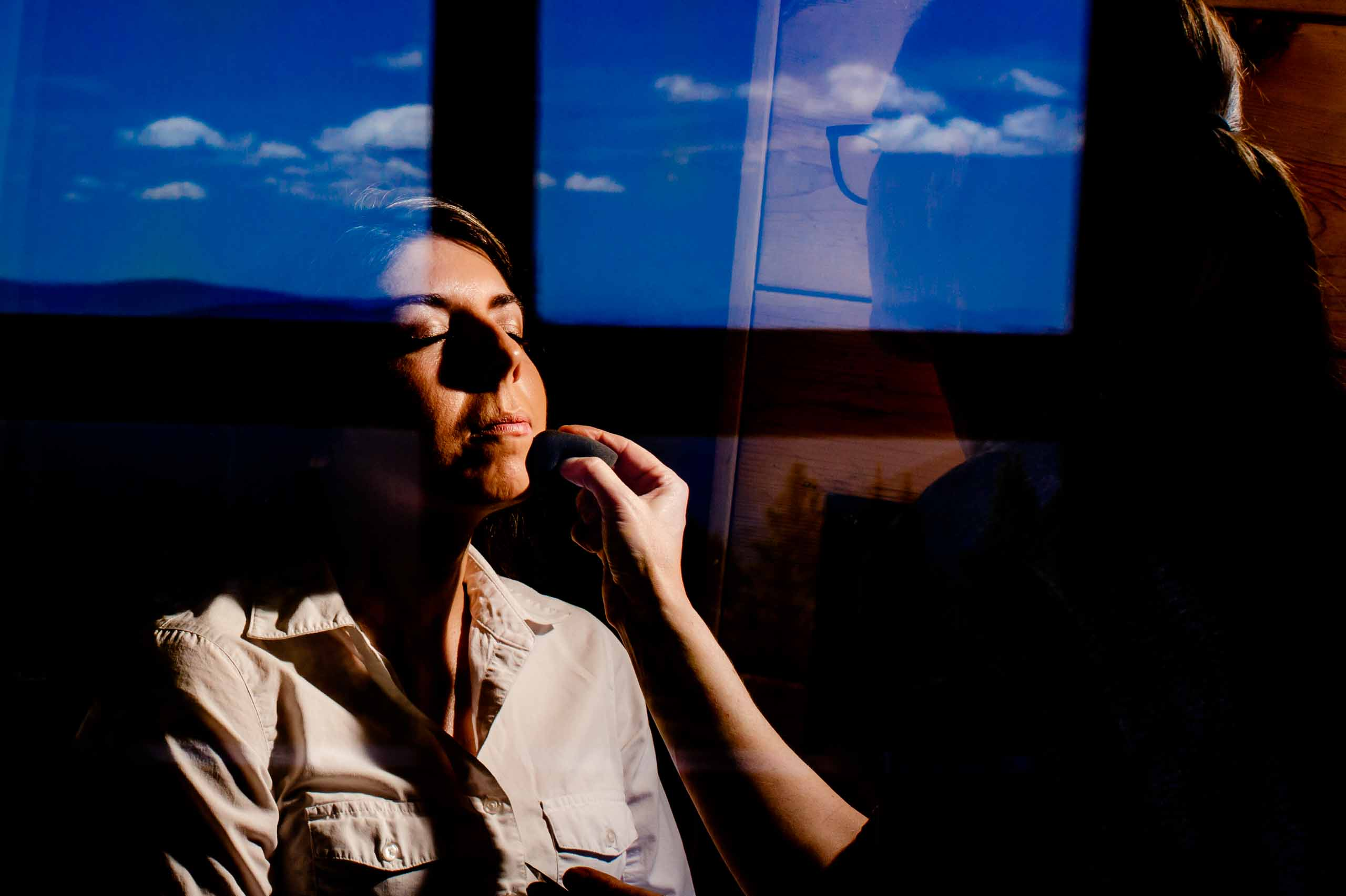 Reflective photo of bride getting ready for her Timberline Lodge Wedding
