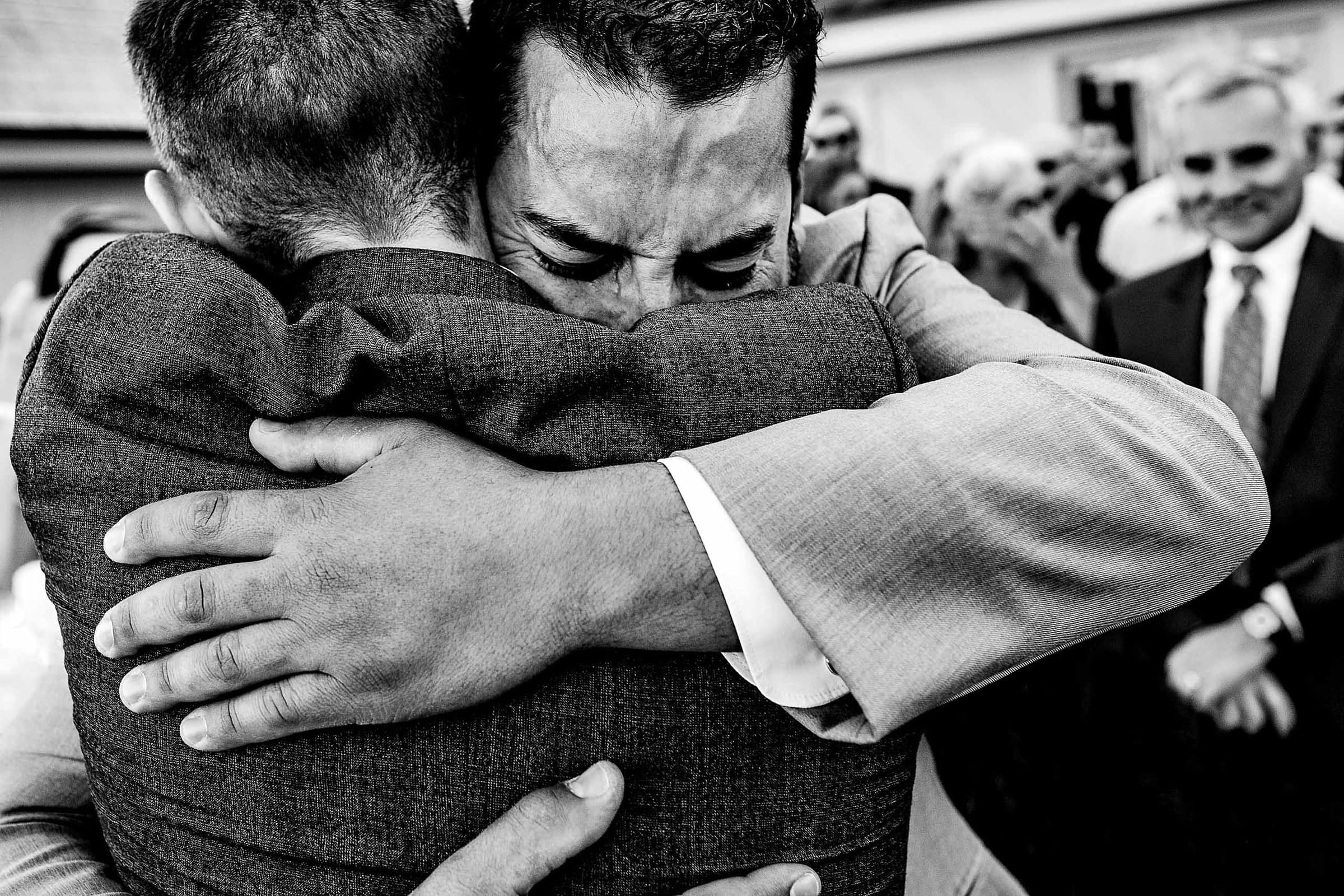 Emotional hug from best man with the groom during a Timberline Lodge Wedding ceremony