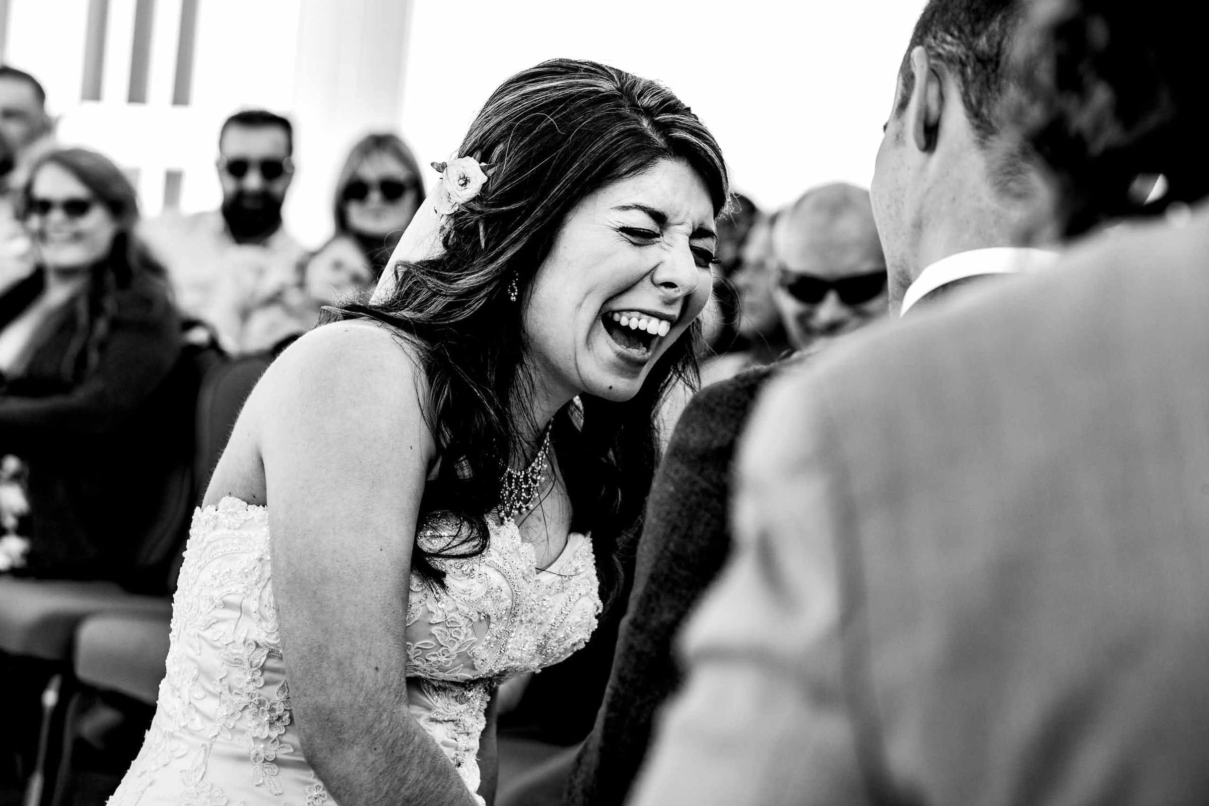 Emotional bride laughing during a Timberline Lodge Wedding ceremony