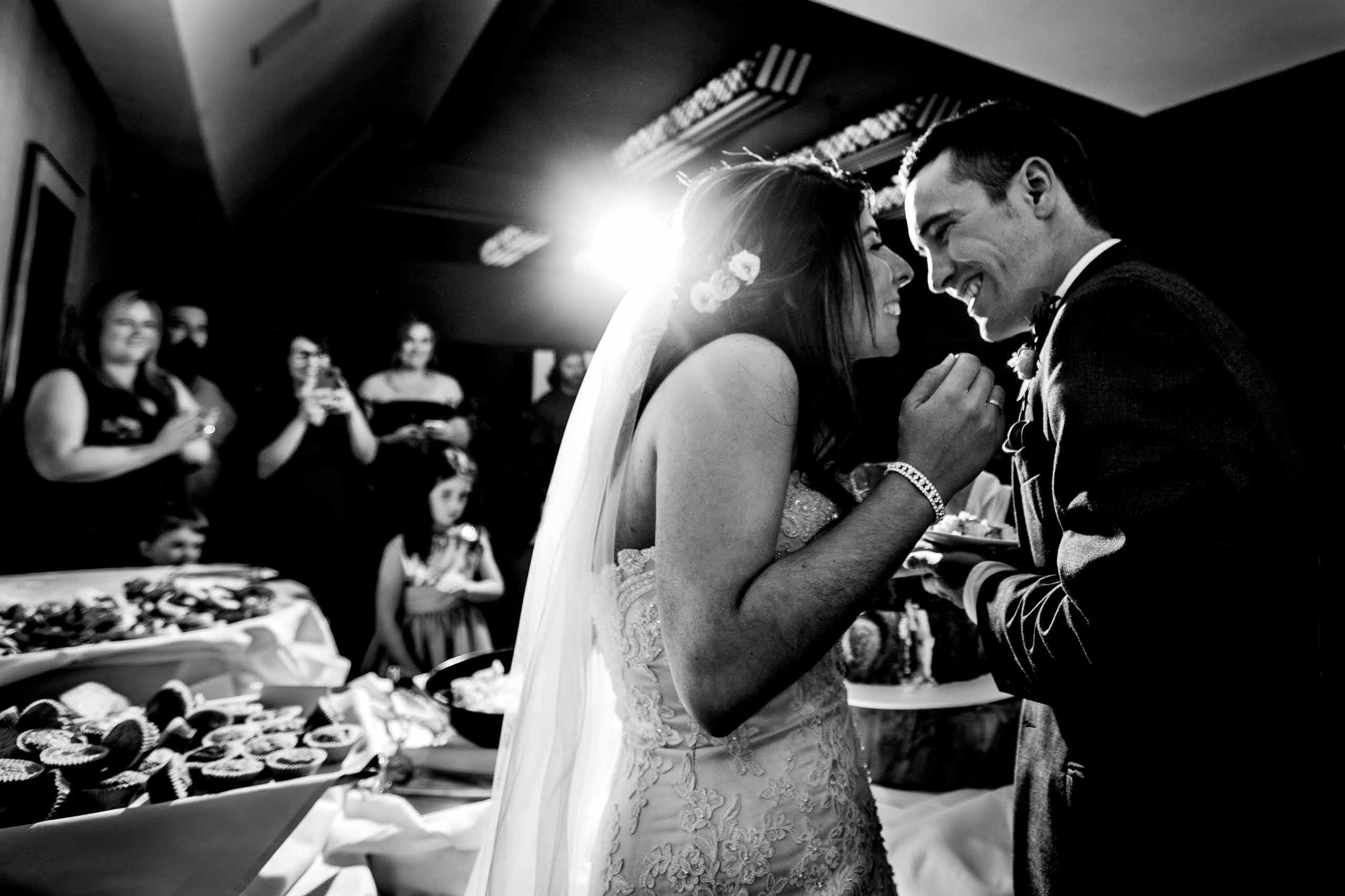 Bride and groom excited cutting their cake during their Timberline Lodge Wedding reception