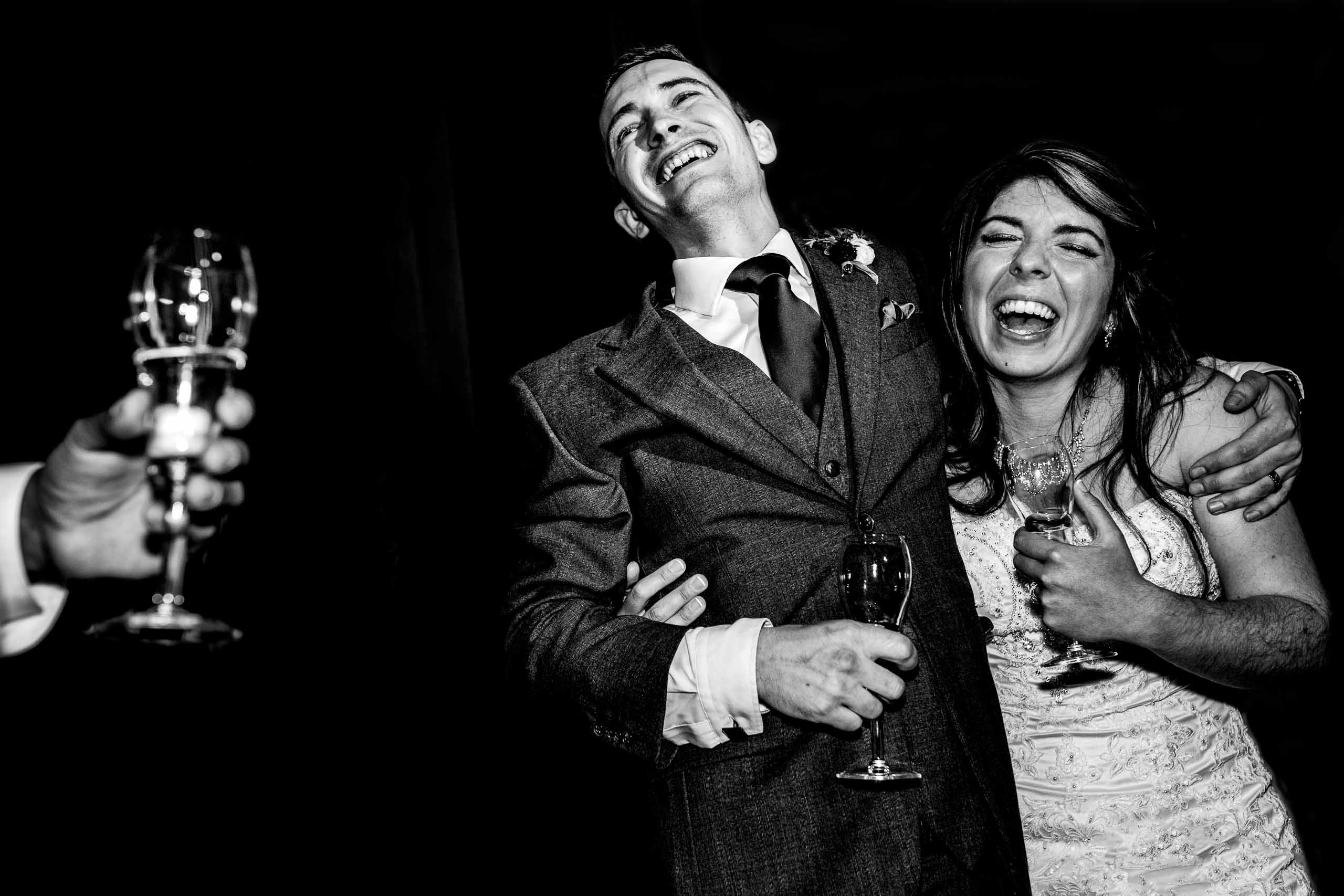 Bride and groom laughing from best man speech during their Timberline Lodge Wedding reception