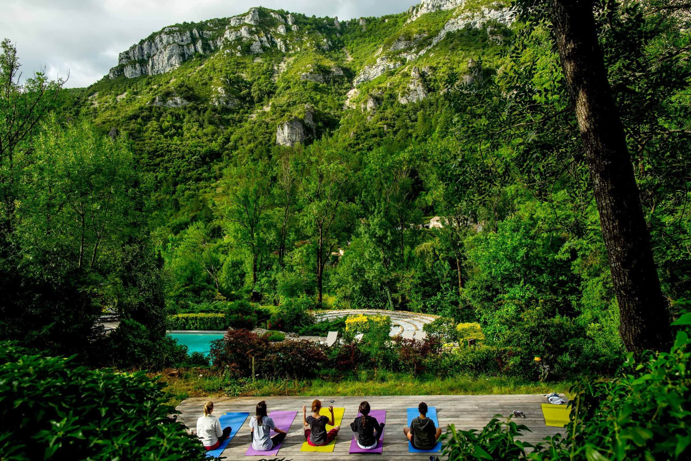 Bride and friends practicing morning yoga before a Chateau Zen Wedding in the South of France near Montpelier