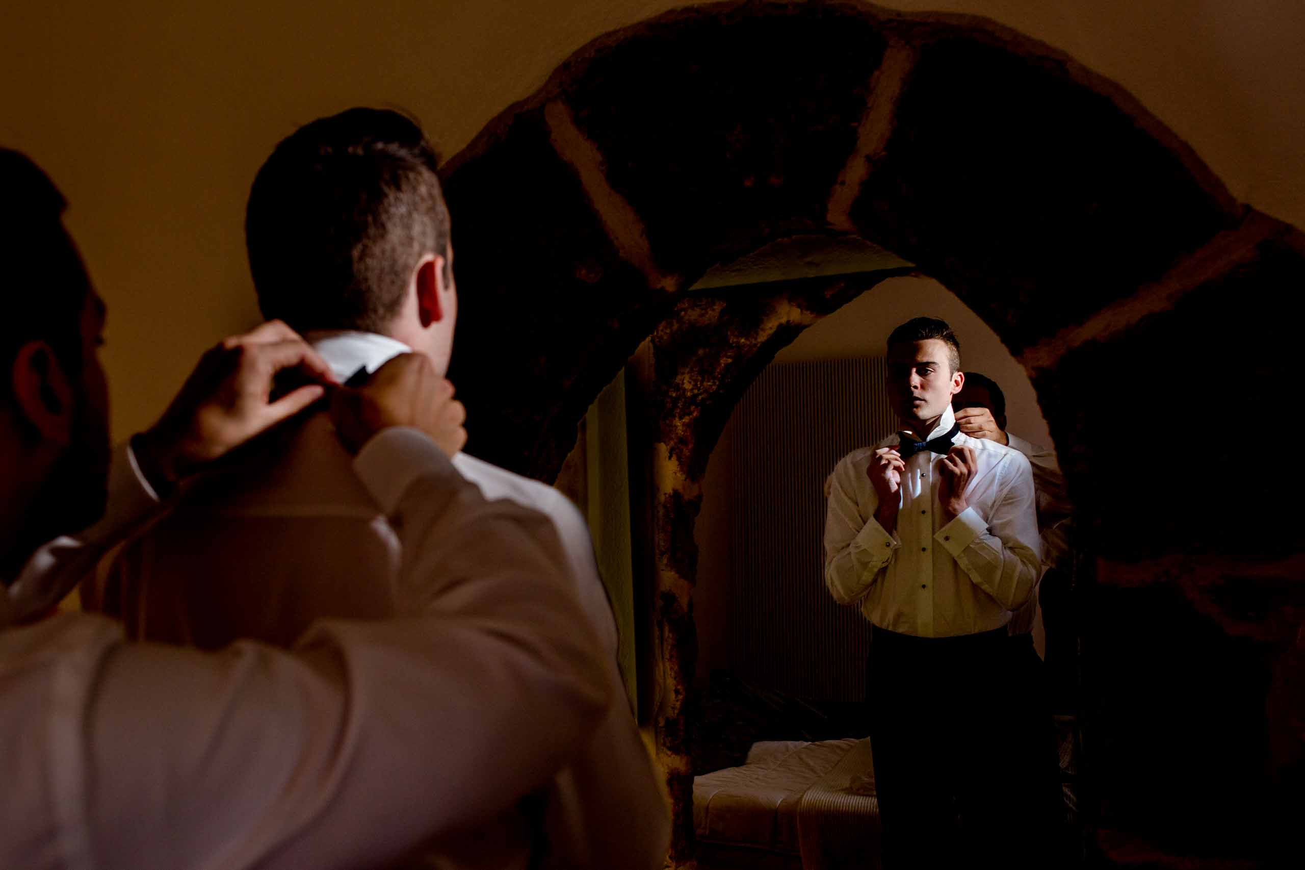 Creative photo of groom getting ready for his Chateau Zen Wedding in the south of France near Montpelier.