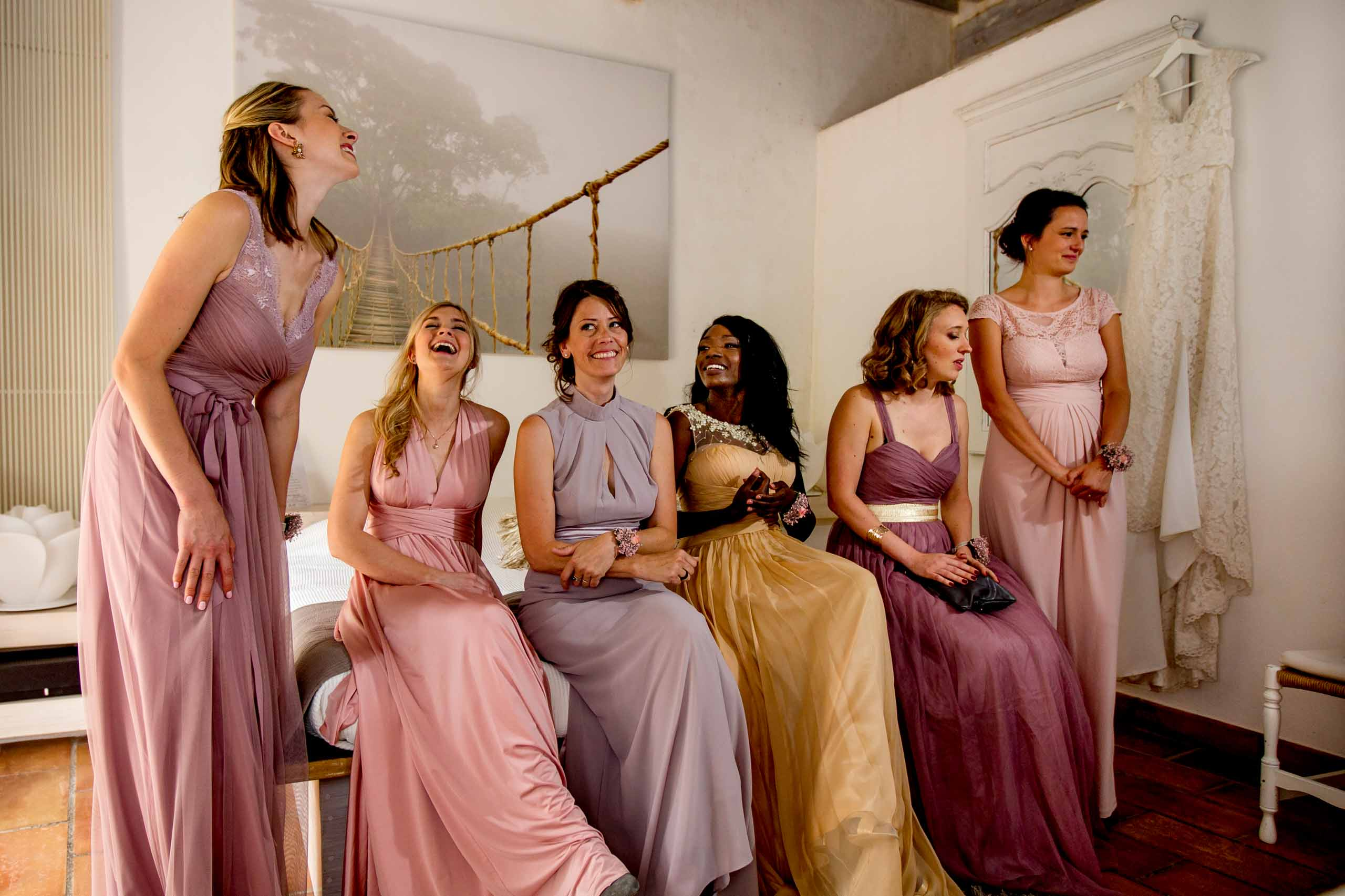 Beautiful bridesmaids laughing together with bride getting ready for her Chateau Zen wedding in the South of France.