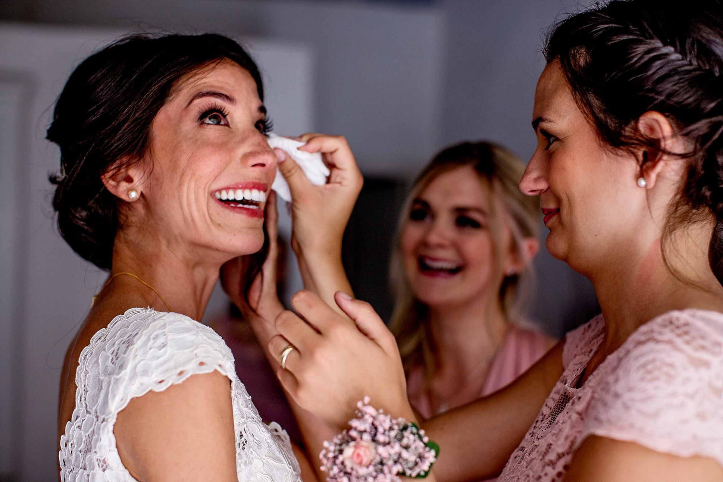 Beautiful bridesmaids crying together with bride getting ready for her Chateau Zen wedding in the South of France near Montepelier.