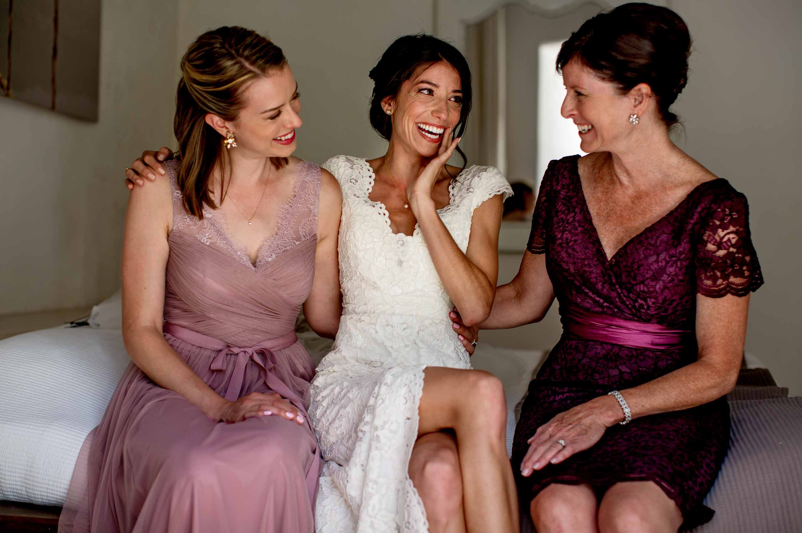 Bride laughing with best friend and mother before her Chateau Zen wedding in the South of France.