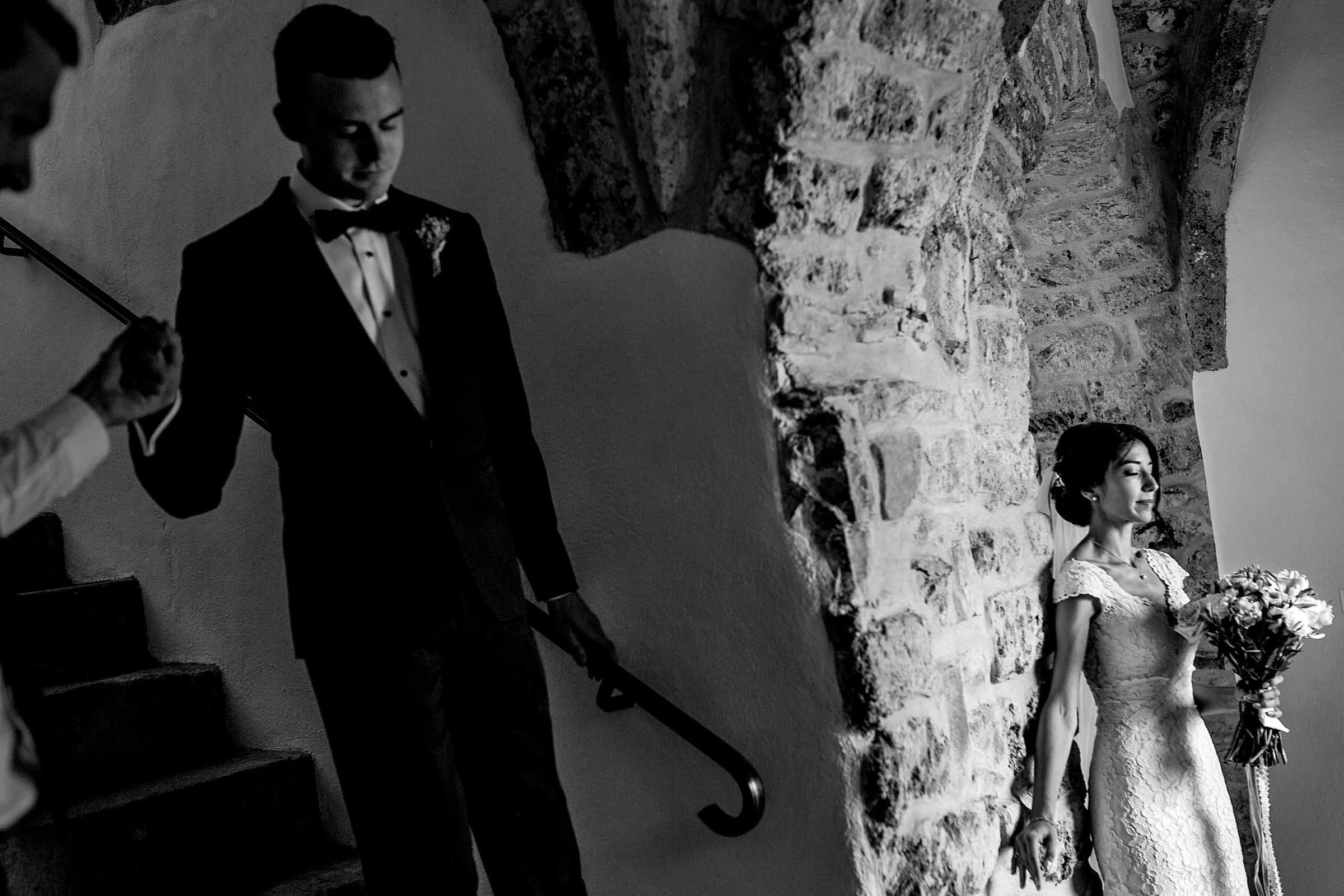 Groom being led to be with his bride without looking before their Chateau Zen wedding ceremony in the South of France.
