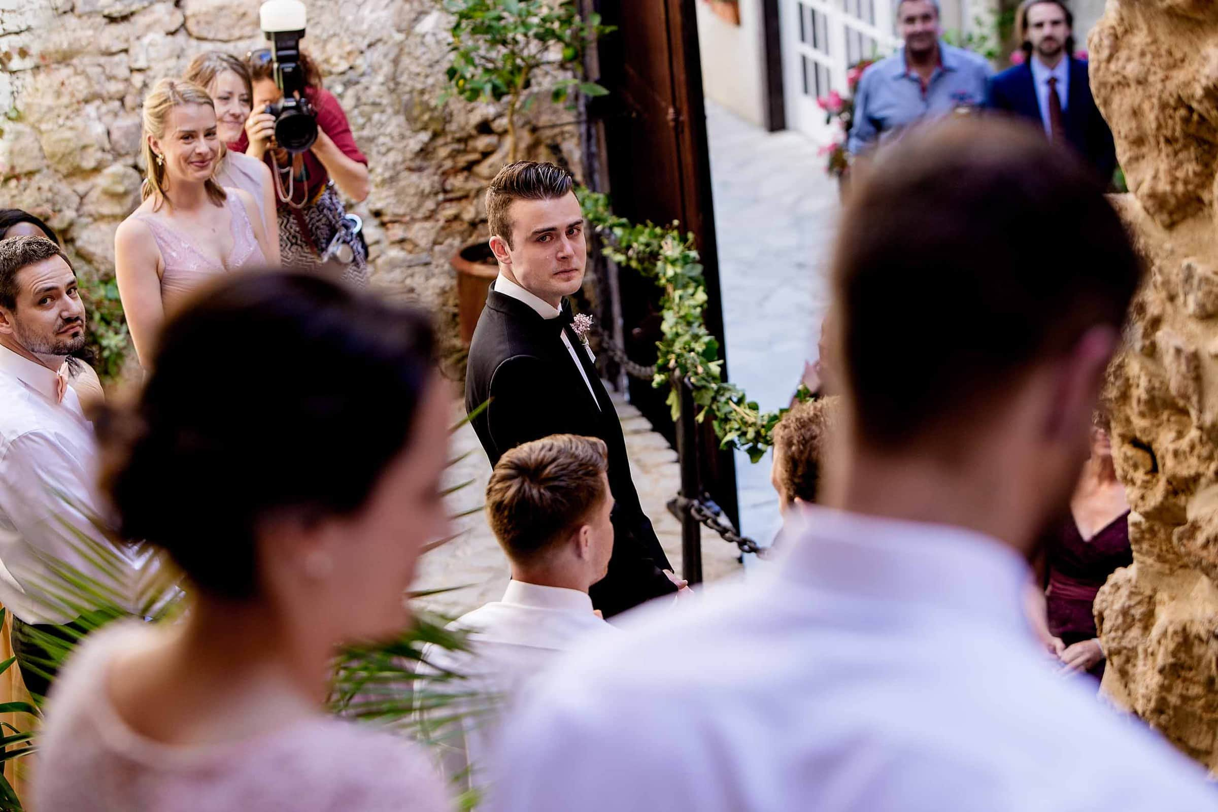 Emotional groom seeing bride for the first time during a Chateau Zen wedding ceremony in the South of France near Montepelier.