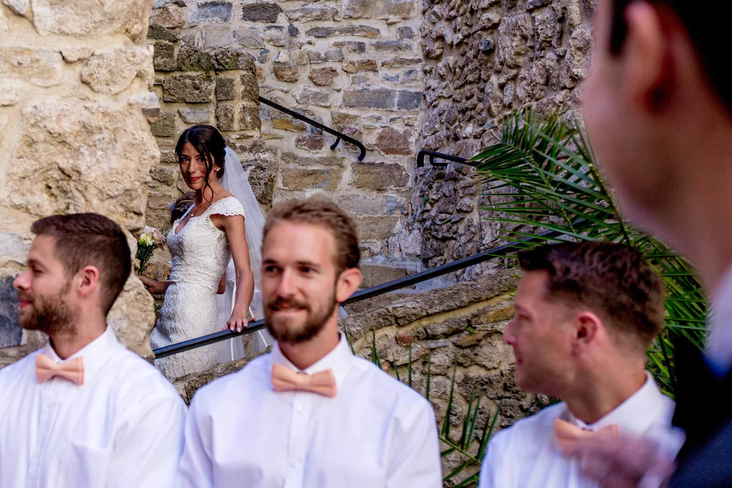 Emotional bride seeing groom for the first time during a Chateau Zen wedding ceremony in the South of France near Montepelier.